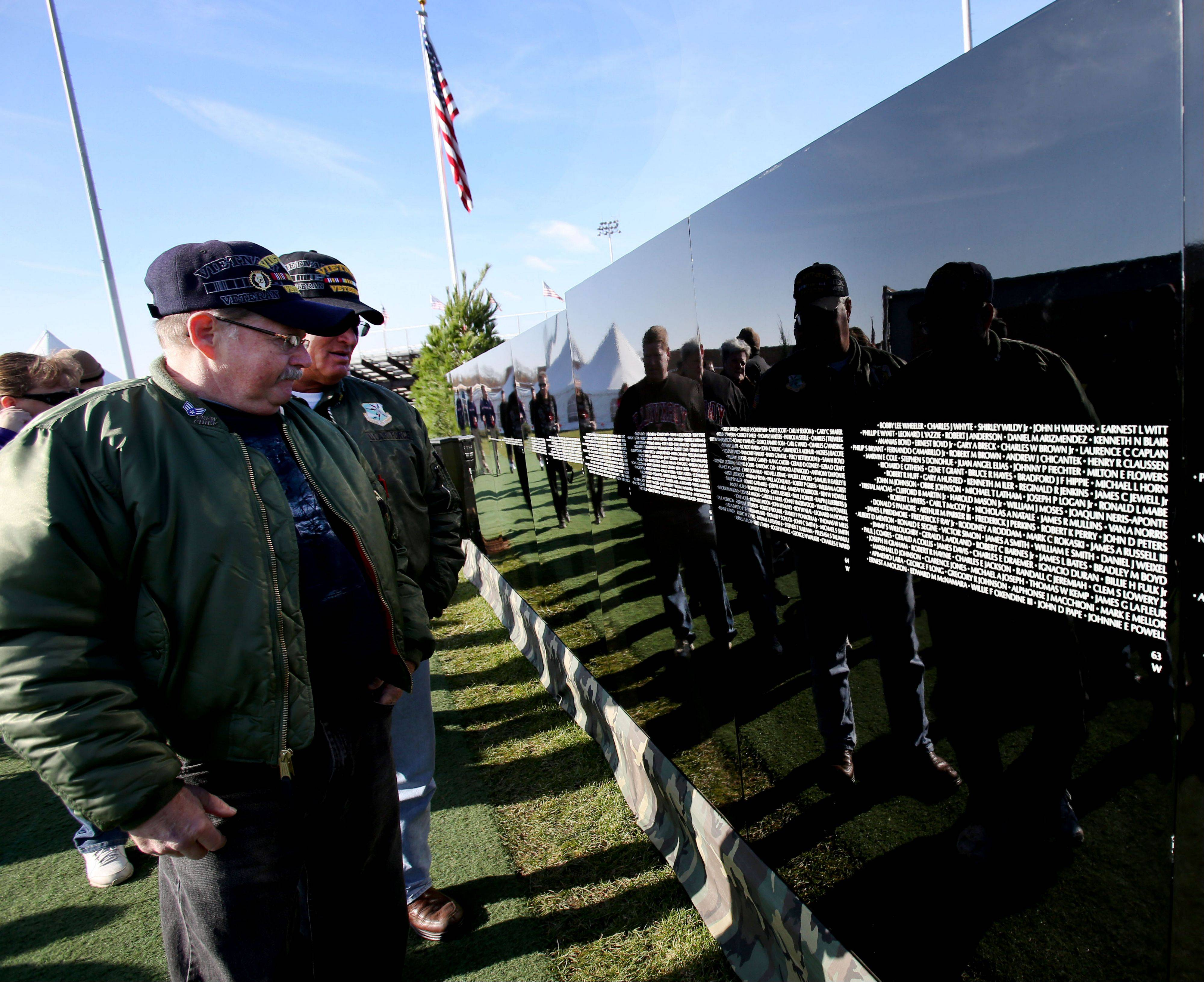 Vietnam veterans Wayne Young of Plainfield, left, and Peter Meier of Aurora view The Moving Wall before the opening ceremonies Friday at West Aurora High School.