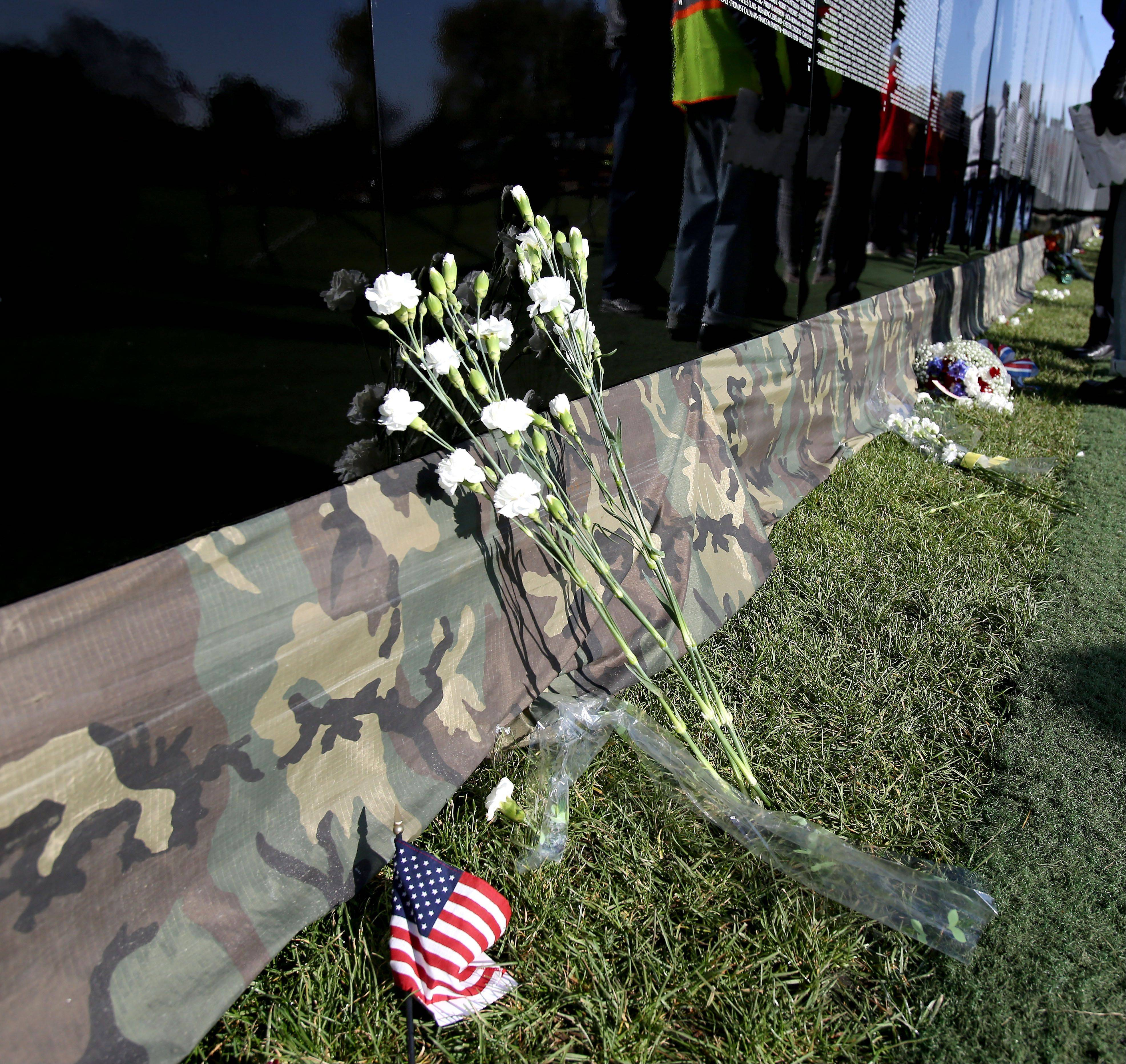 Flowers, photos and other memorials left at the base of the wall were commonplace by Friday morning.