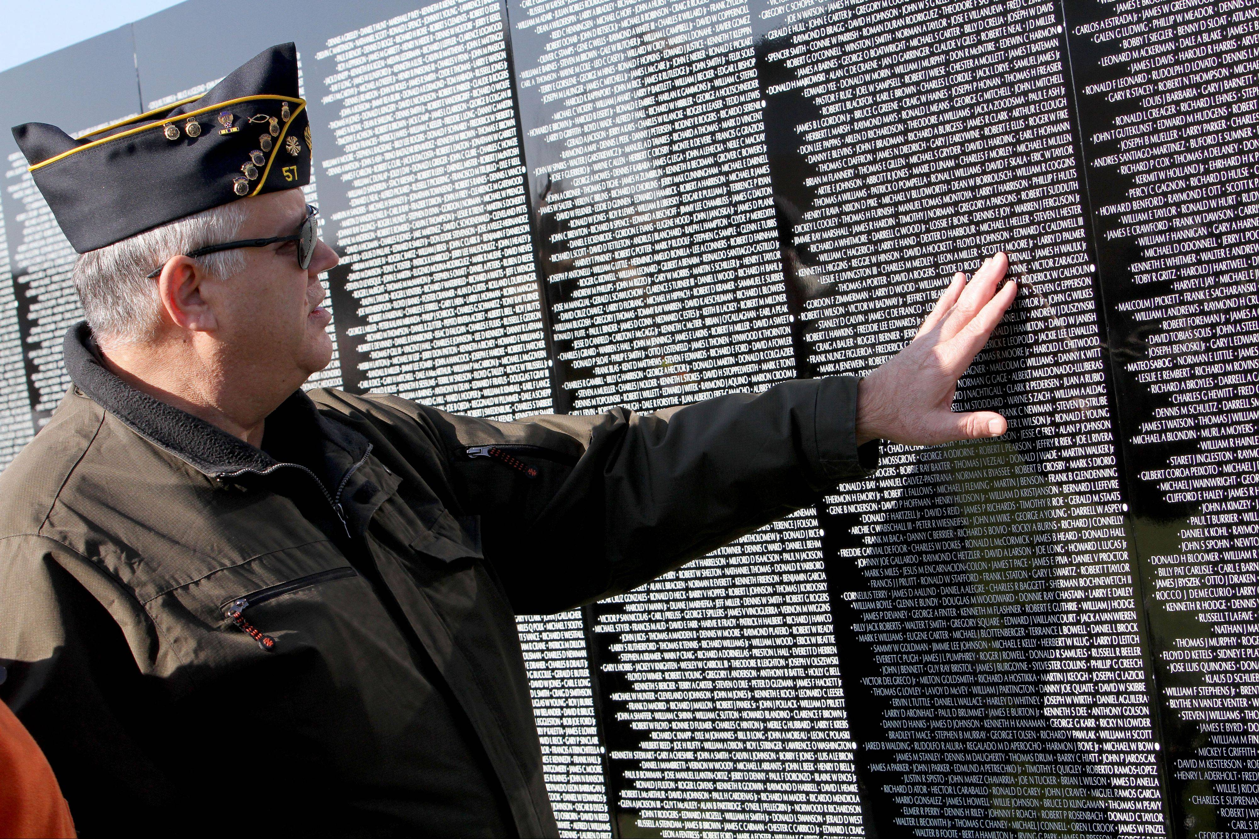 Ronald J. Juvingo, a Vietnam veteran, who served from 1967 to 1971, visited The Moving Wall Friday morning.
