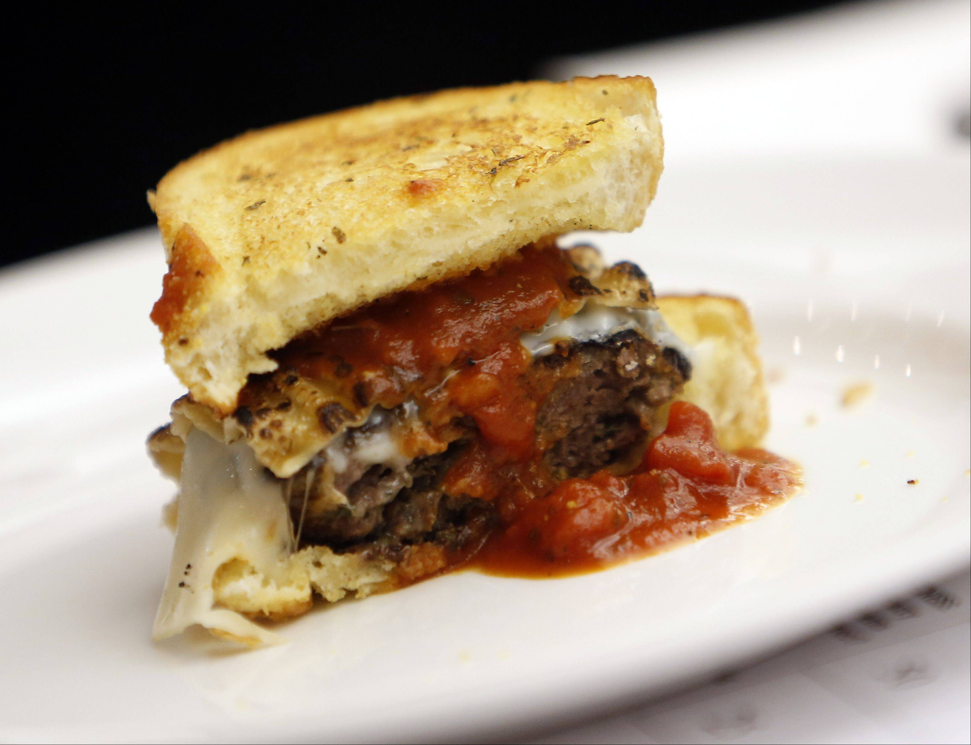 Sabrina Kozin's Lasagna Burger is shown at Elgin Community College's fifth annual ECC-Prime BurgerHouse Burger Competition Friday at the Spartan Terrace Restaurant in Elgin.