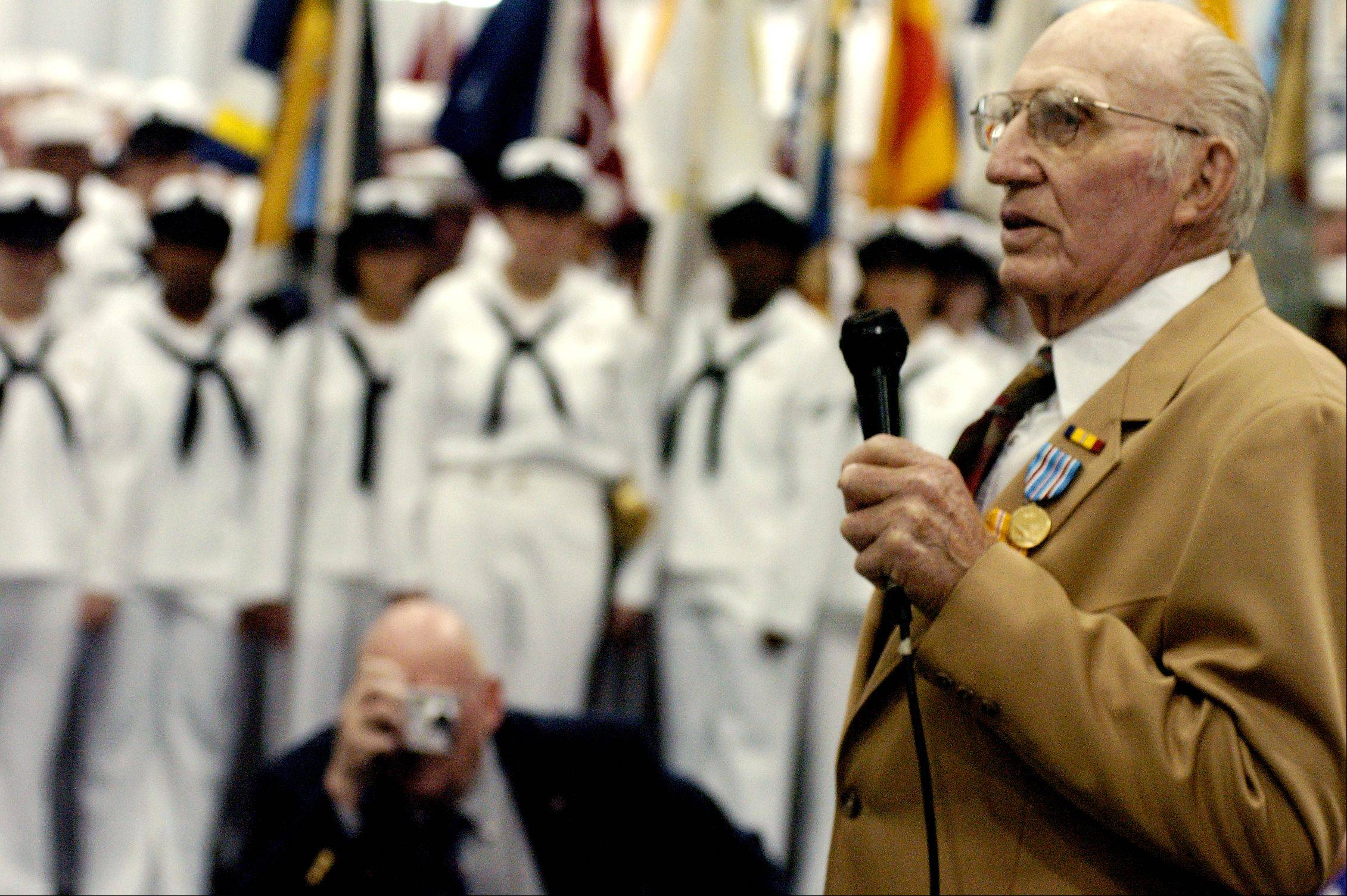 George Gebes, a World War II Navy veteran, says a few words of thanks to recruits and guests after receiving medals overdue by nearly 60 years at Great Lakes Naval Center in North Chicago in 2004. Gebes died Monday at 98.