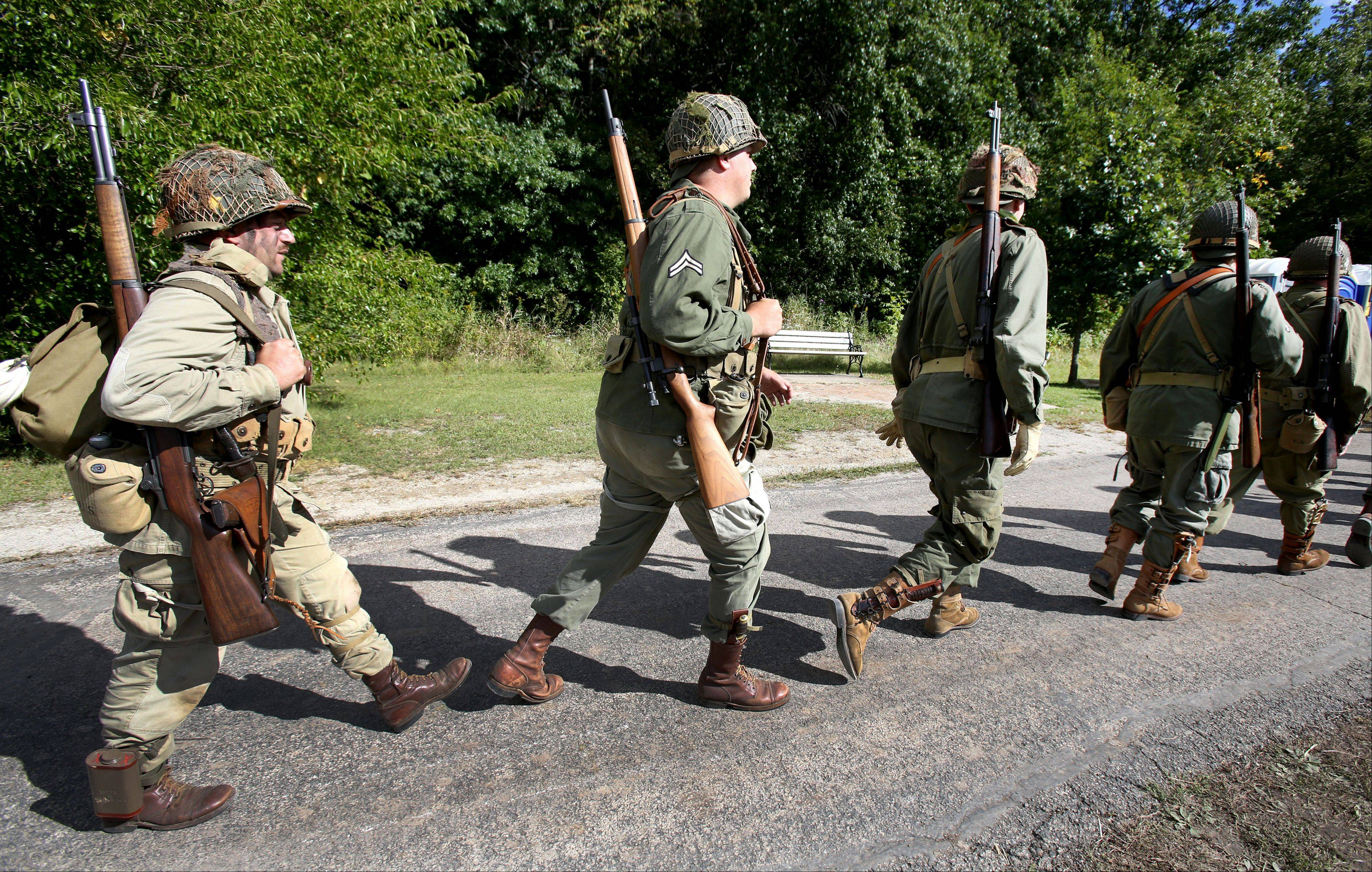 Steve Zahareas marches to a field battle at World War II Days in Rockford.