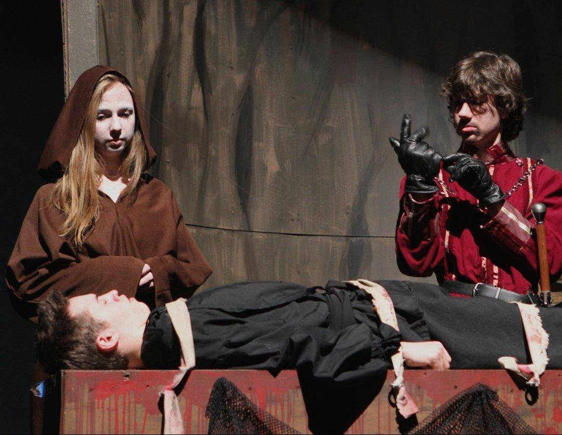 "From left, Helen Johnson as Albino, Zane Shaw as Westley and Chris Kubiak as Count Rugen rehearse for ""The Princess Bride"" at Geneva High School."