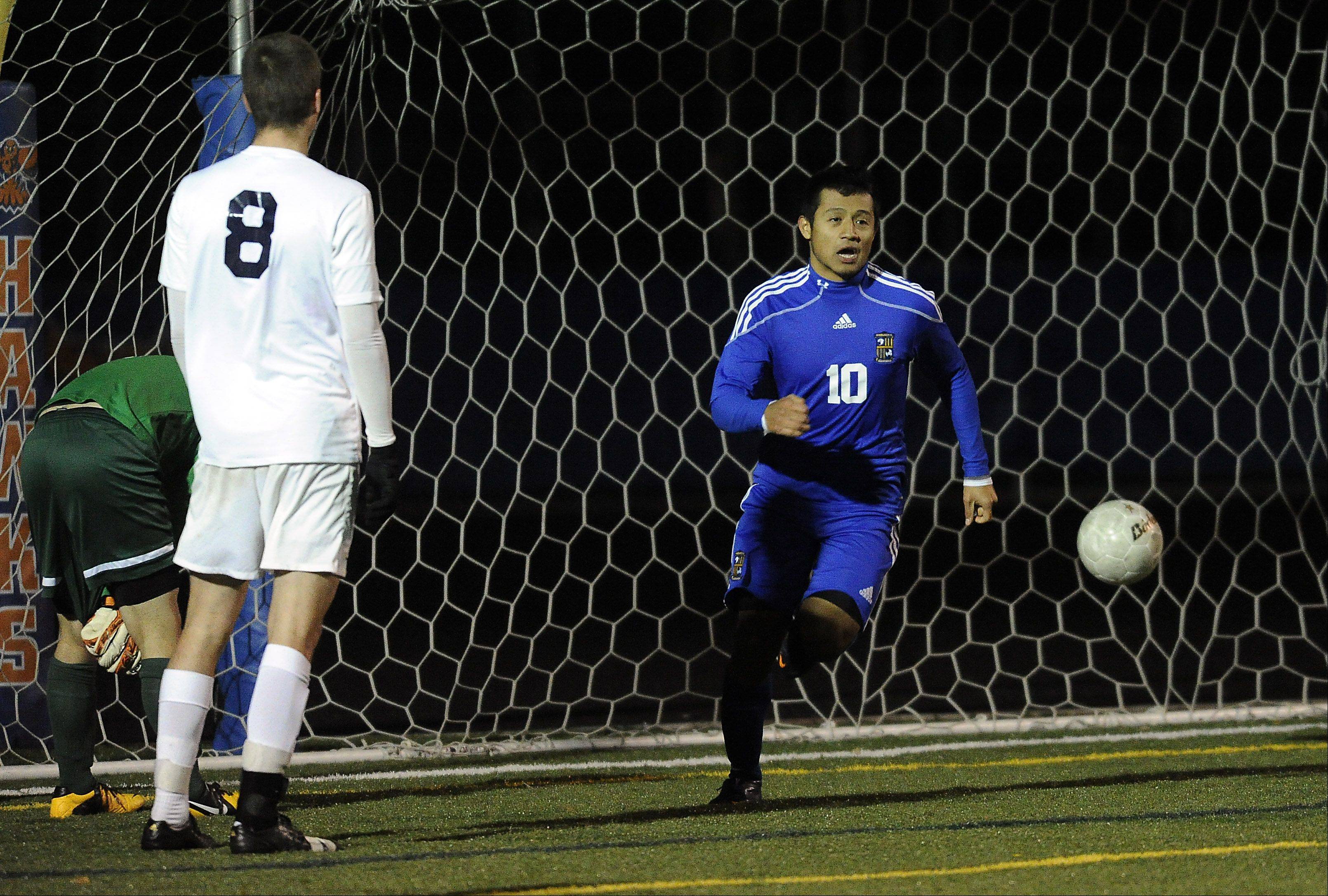 Wheeling's Ivan Mancilla scores the third goal of the game as Lake Park's Rike Tithof-Steere looks on in the second half of the Class 3A boys soccer state semifinals at Hoffman Estates on Friday.