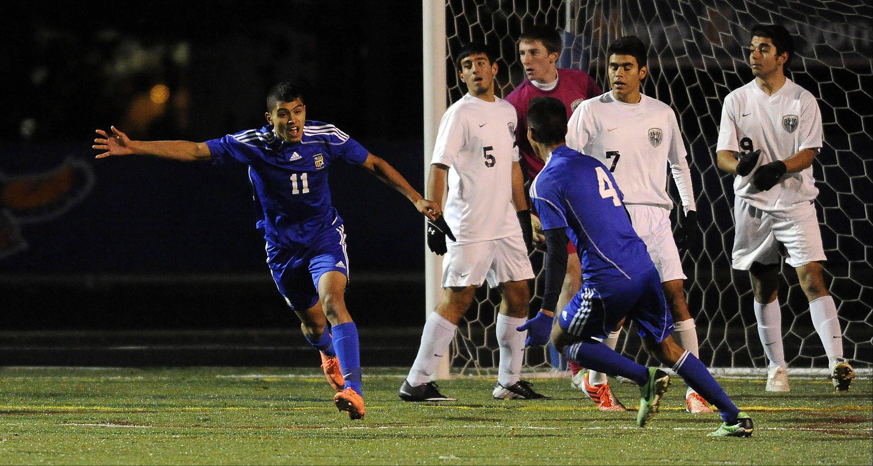 Wheeling's Luis Herrera scores the first goal as Lake Park players look stunned in the first period in the boys Class 3A state semifinals at Hoffman Estates High School on Friday.