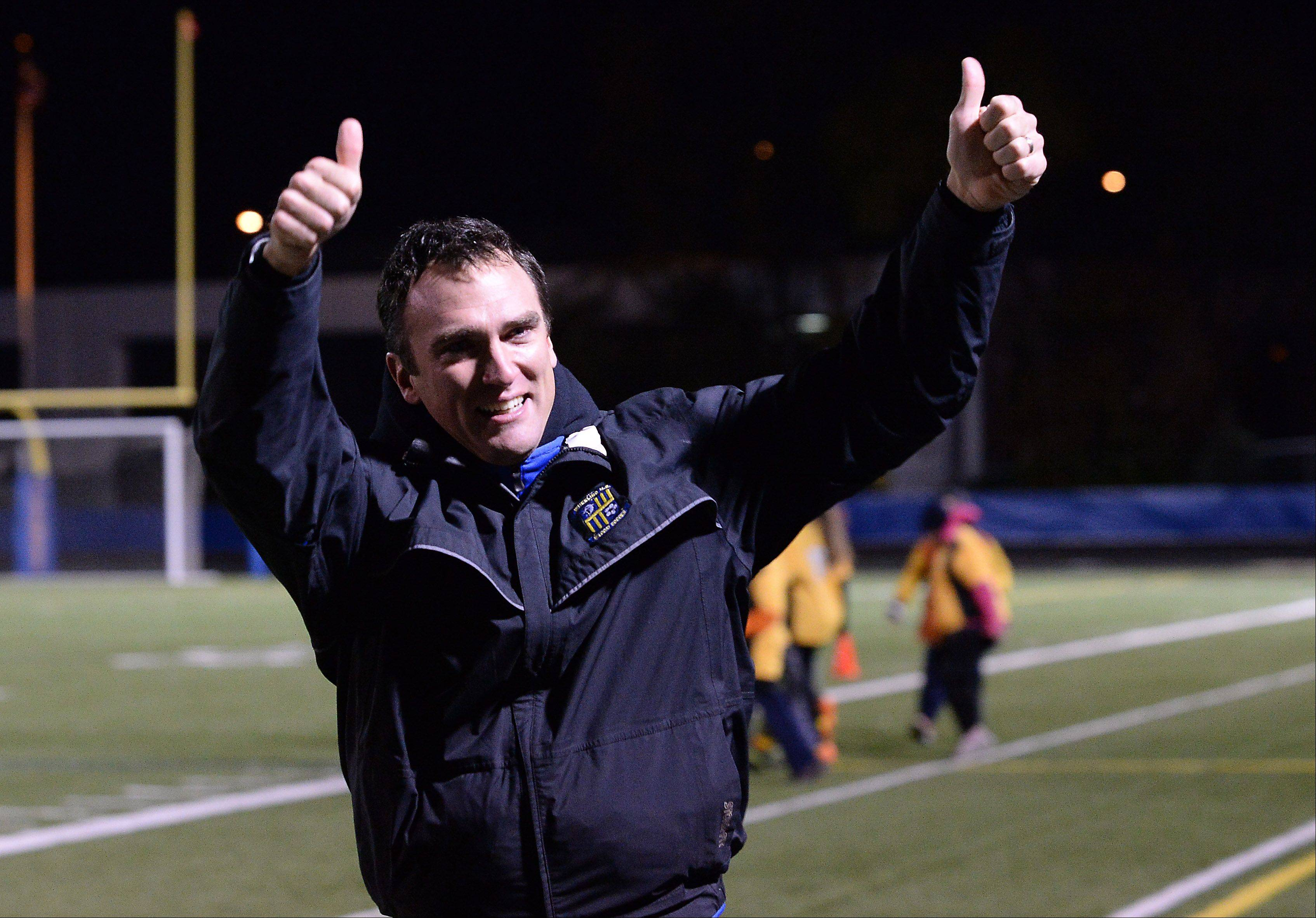 Wheeling coach Ed Uhrik gives the thumbs-up to fans after the Wildcats' 3-0 victory over Lake Park in the Class 3A boys soccer state semifinals at Hoffman Estates on Friday.