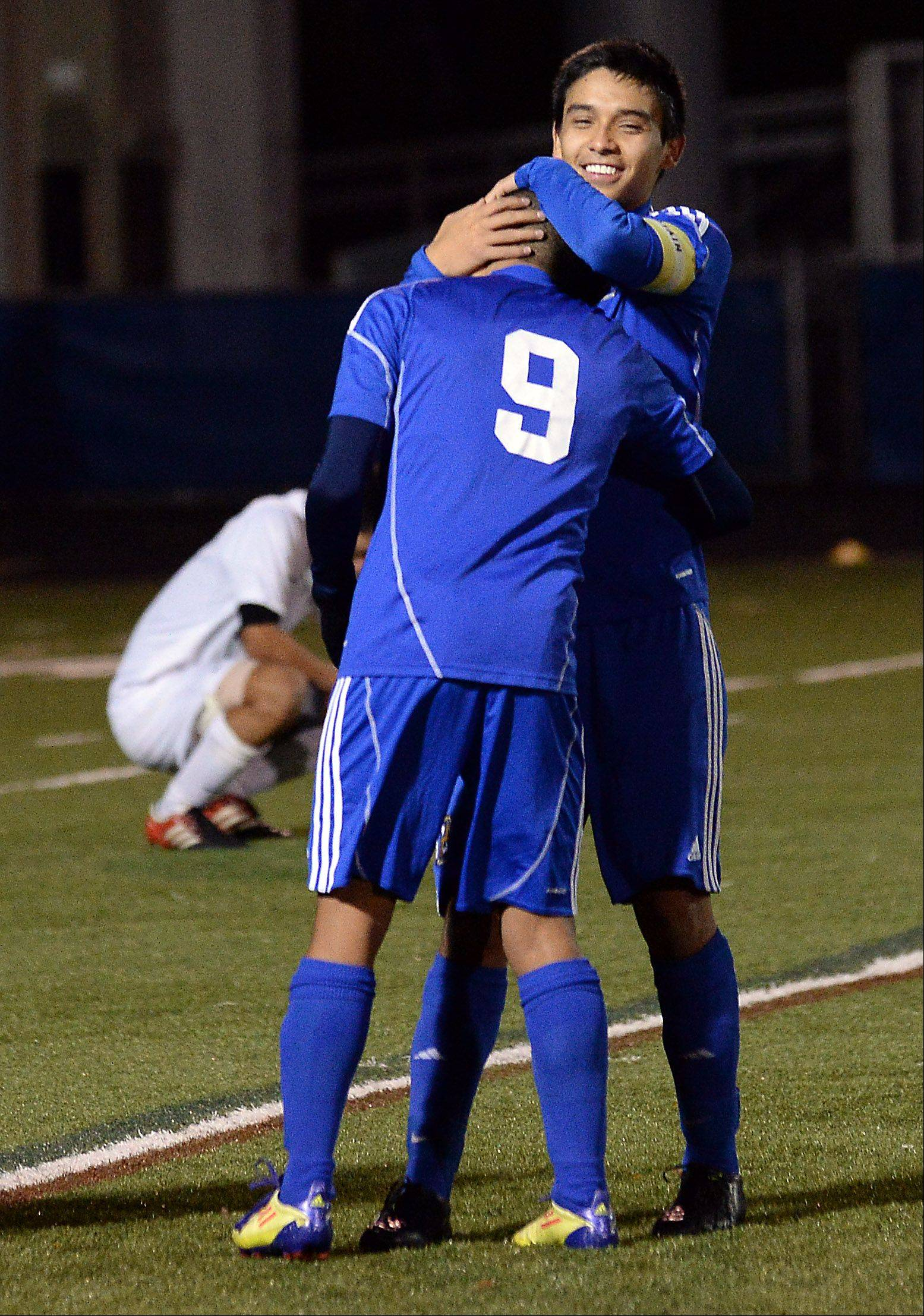 Wheeling's Jose Garcia and Frank Estrada celebrate their 3-0 victory over Lake Park in the Class 3A boys soccer state semifinals at Hoffman Estates.