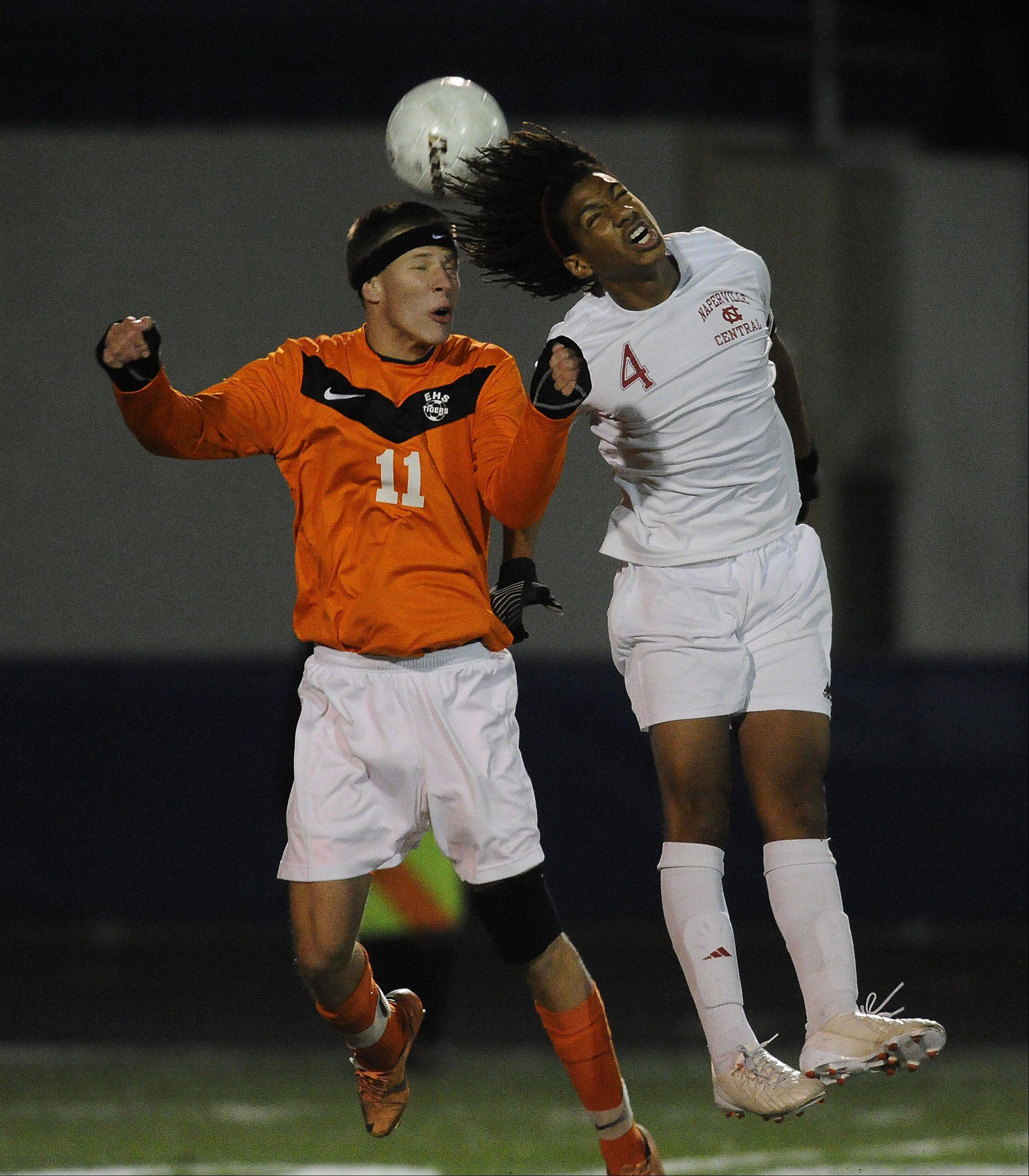 Naperville Central's Devon Amoo-Mensah goes up against Edwardsville's Justin Lowry for control of the ball.