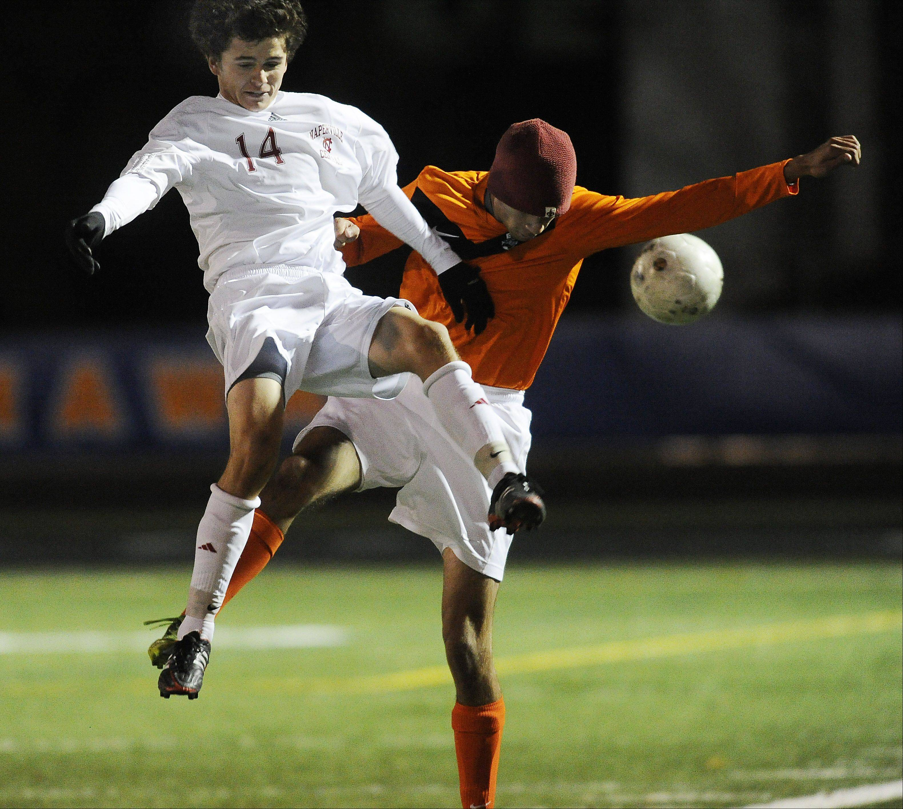 Naperville Central's David Murphy goes up against Edwardsville's Suleman Bazai.