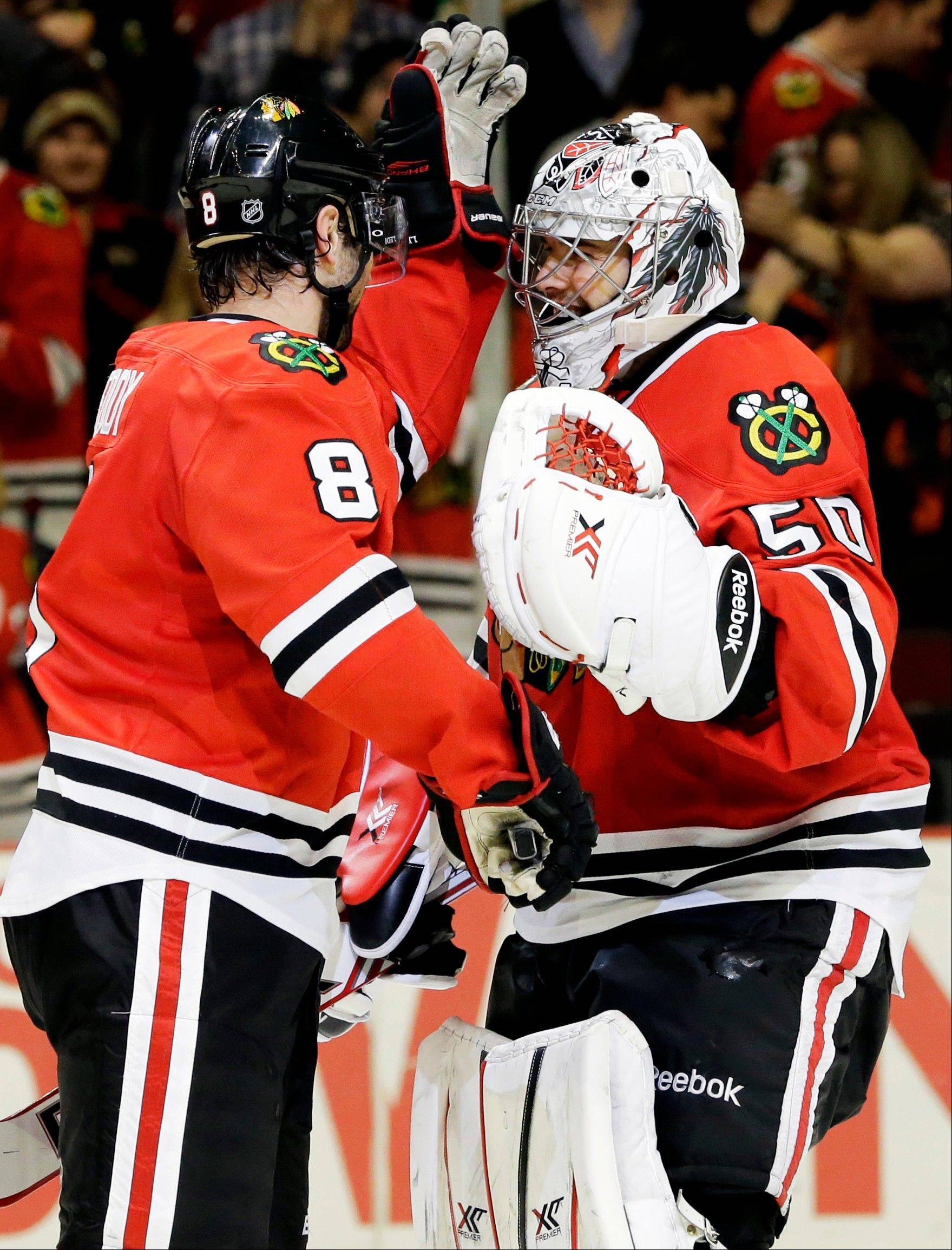 Associated PressThe Blackhawks will go with goalie Corey Crawford, right, for Saturday's game, but head coach Joel Quenneville would not say if backup Nikolai Khabibulin will start Sunday's game.
