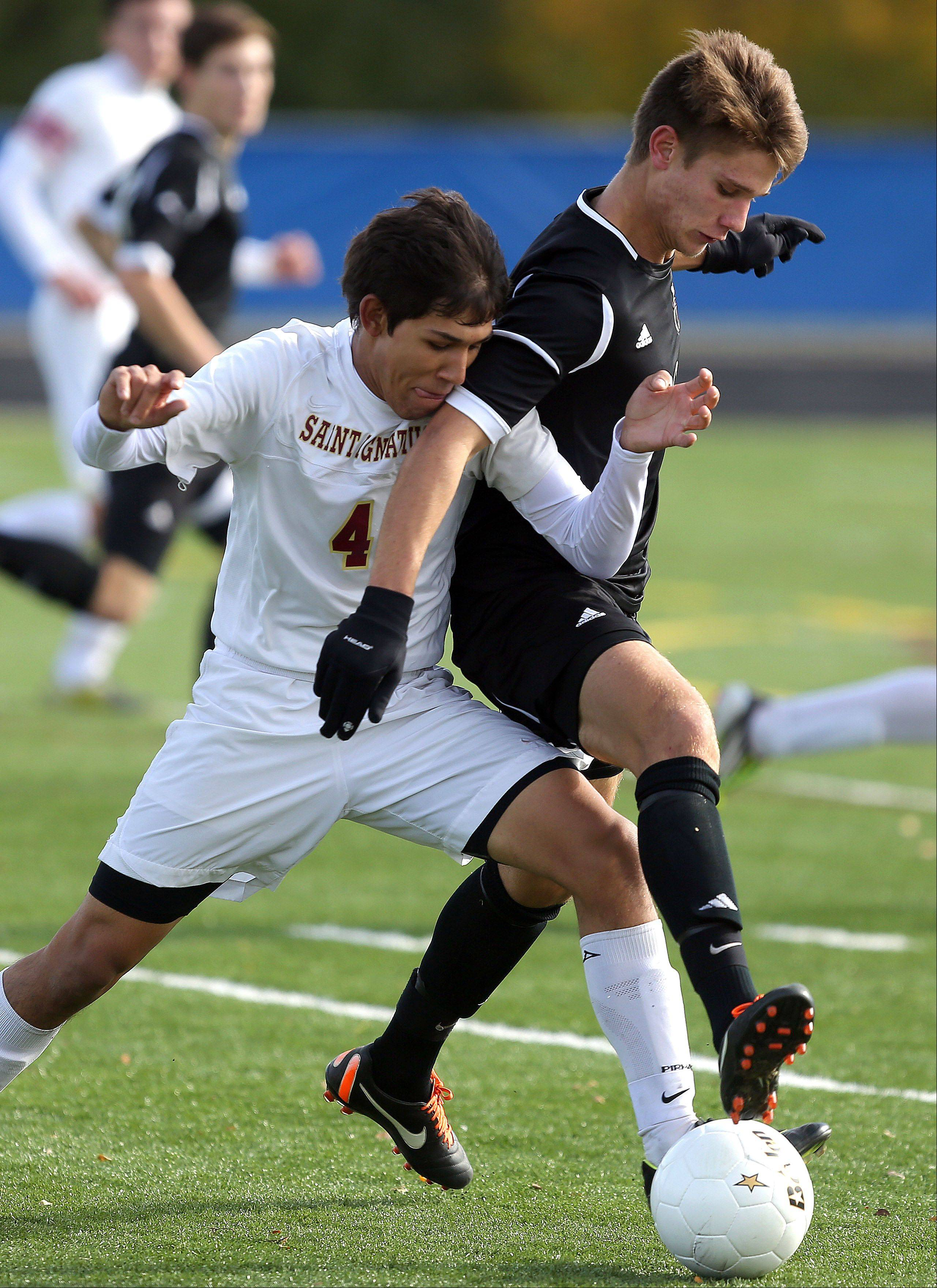 Wheaton Academy's Ty Seager, right battles with St. Ignatius' Jonathan Viera in Class 2A state semifinal game at Hoffman Estates High School Friday.