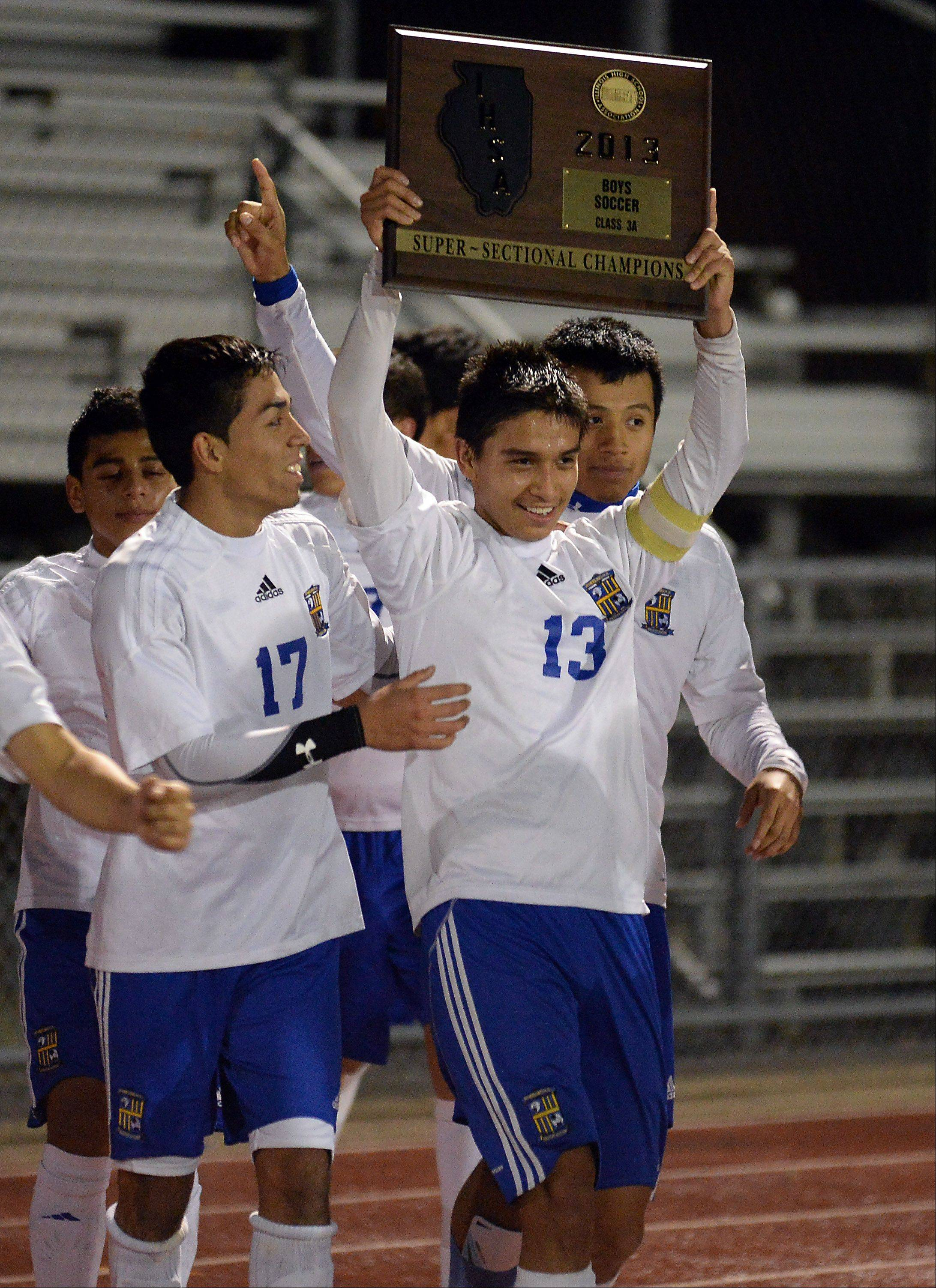 Wheeling's Jose Garcia and teammate Michael Hernandez celebrate their 2-1 victory in the super sectional on Tuesday.