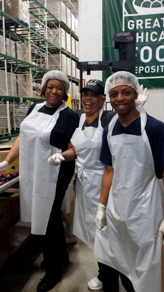 Pictured at the Greater Chicago Food Depository are (from left to right): Accretive Health employees Shirley Cooper and Jonita Epison, and Donavan Epison, Jonita's grandson.