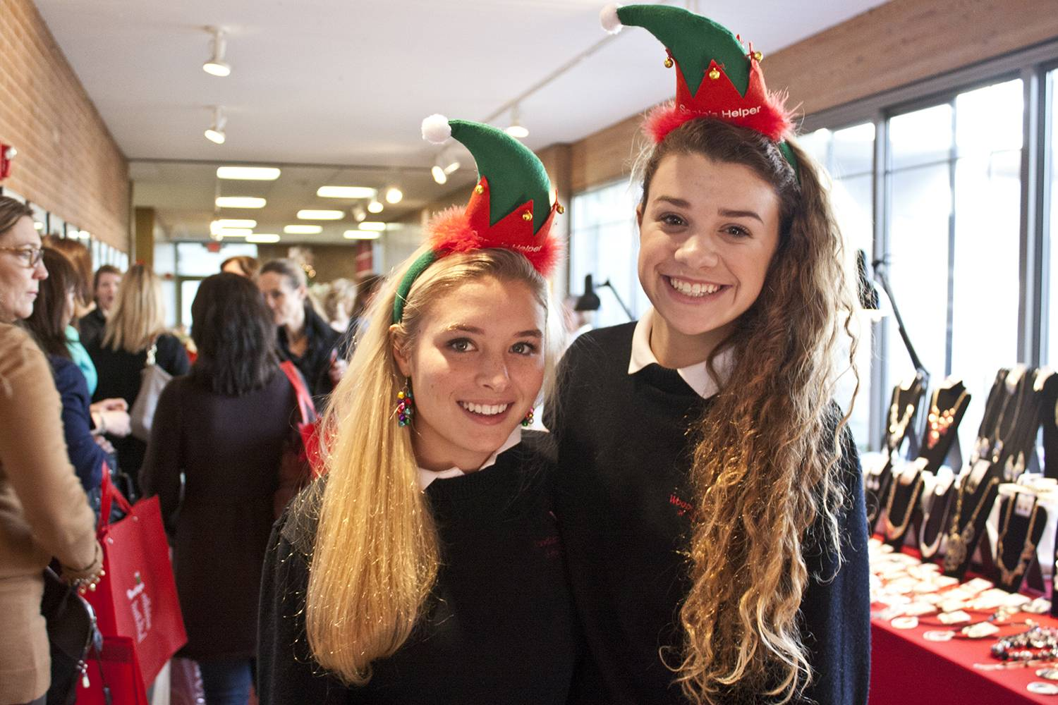Student helpers Honore Olson of Evanston (left) and Ellyse Keller of Lake Bluff were on hand to assist those attending the boutique portion of last year's Winter Wonderwalk. Both girls are Woodlands Academy seniors this year.