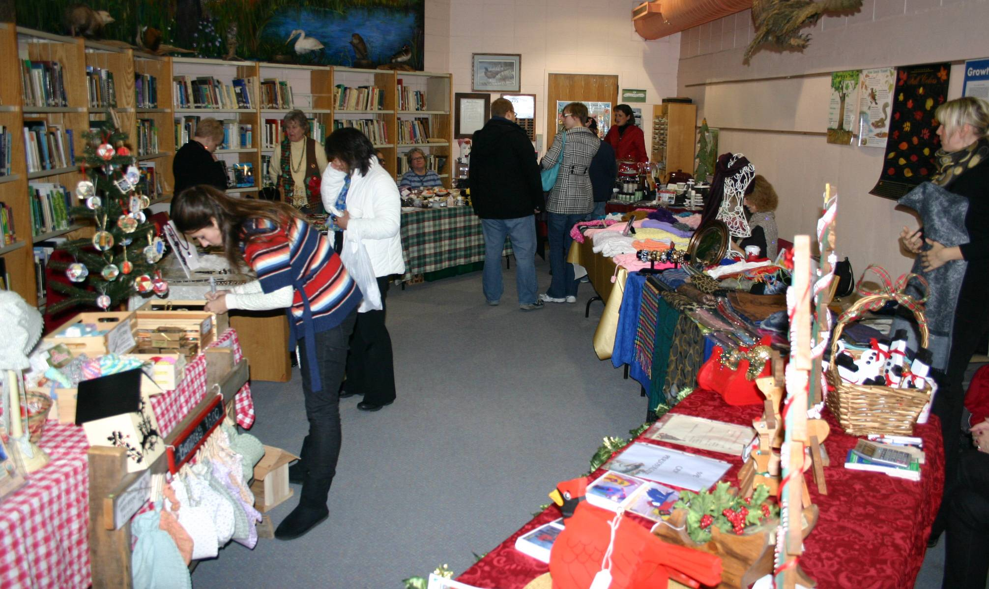 Shoppers take a look at the crafts and gifts available at the Spring Valley Holiday Bazaar.