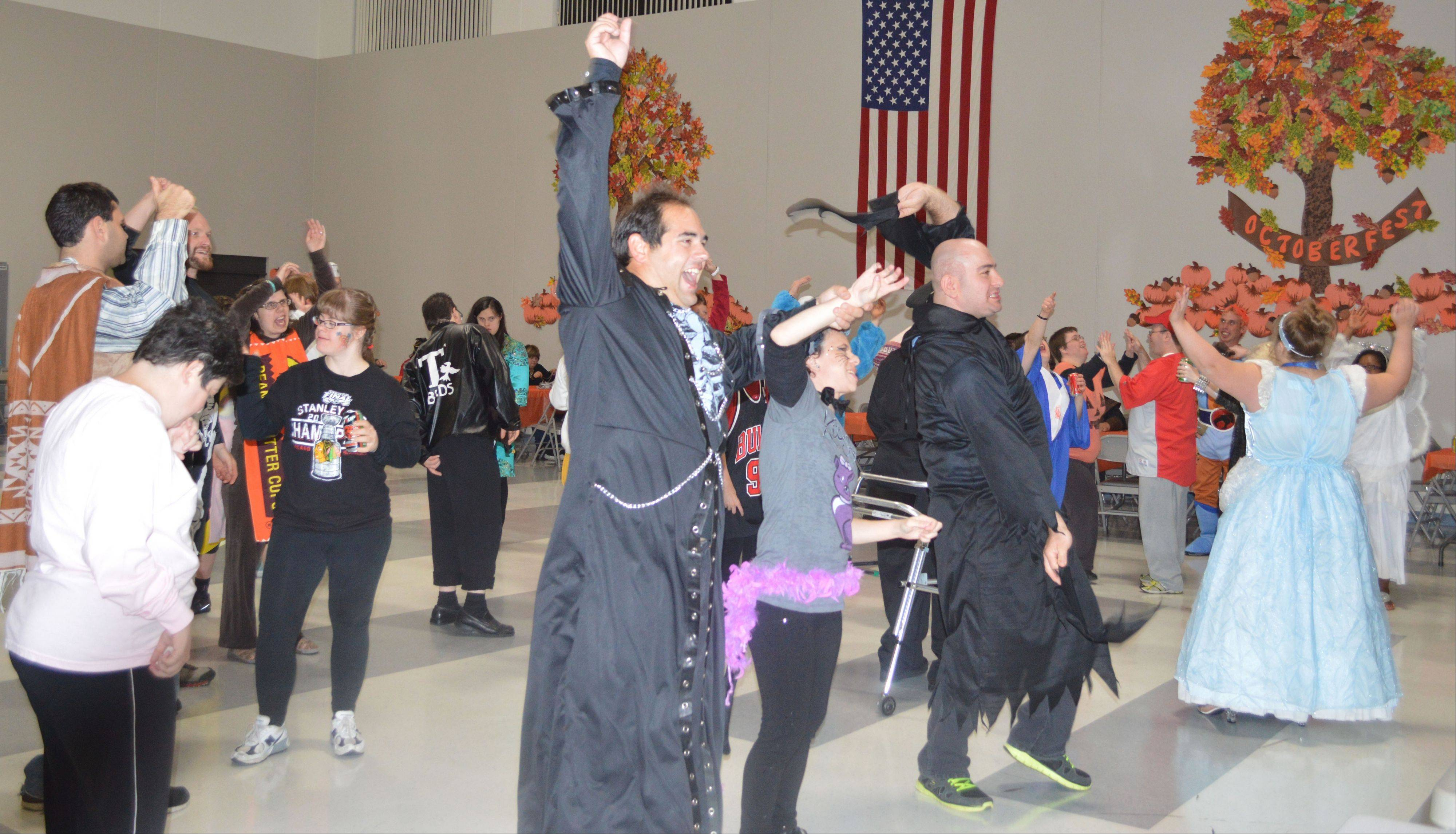 "The crowd goes wild for the ""YMCA"" song at the Halloween Dance."