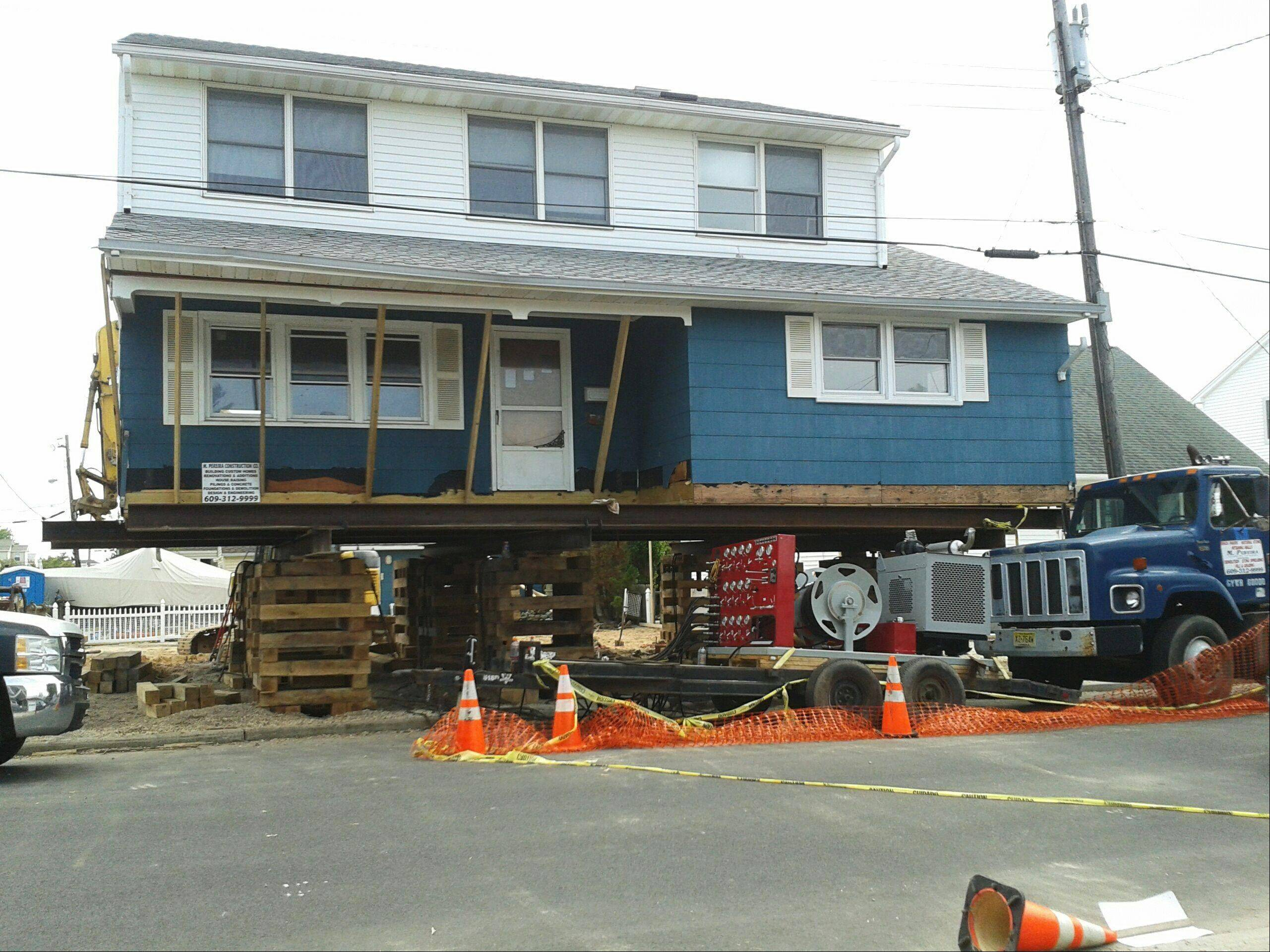 John Paynter�s vacation home in Long Beach Island, N.J., was raised after tropical storm Sandy and now stands 13 feet higher than it did before.