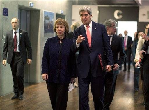 U.S. Secretary of State John Kerry walks with European Union foreign policy chief Catherine Ashton before their meeting with Iranian Foreign Minister Mohammad Javad Zarif in Geneva, Friday Nov. 8, 2013.