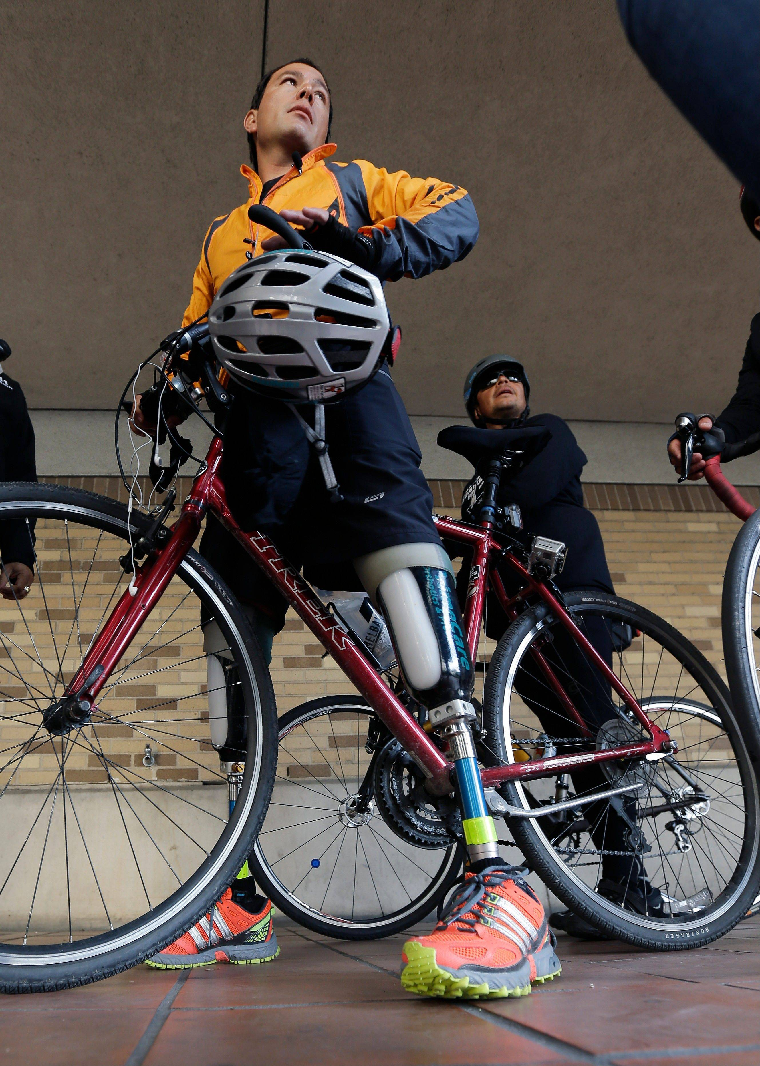 Cyclist Carlos Gutierrez, a double amputee, stands Thursday with his bike in San Antonio. Gutierrez is riding his bike from El Paso, Texas to Austin, Texas, to raise awareness on the situation of political asylum seekers.