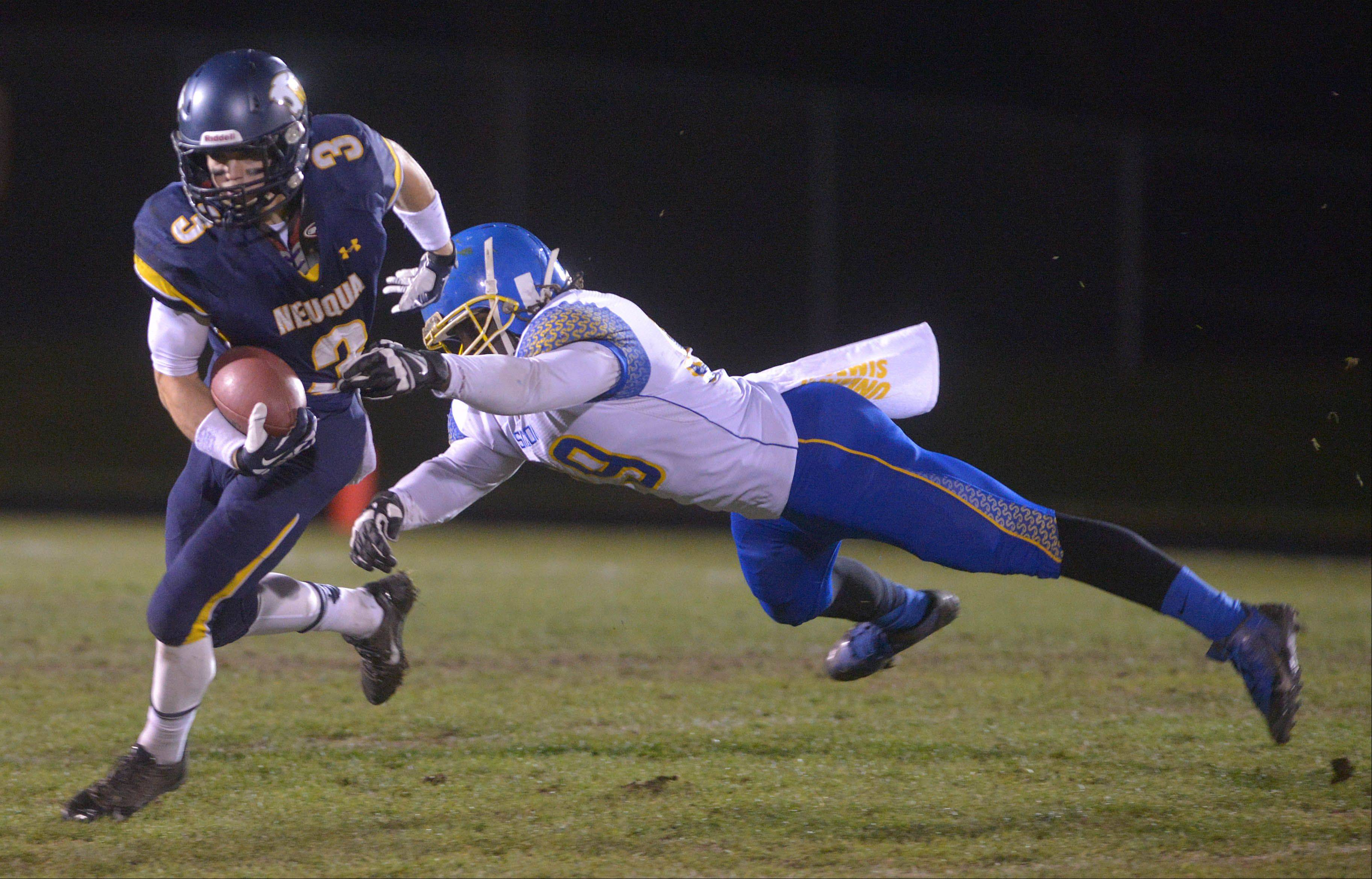 Neuqua Valley�s Mikey Dudek gets past Simeon�s Karlin Entoe Saturday�s football playoff game.