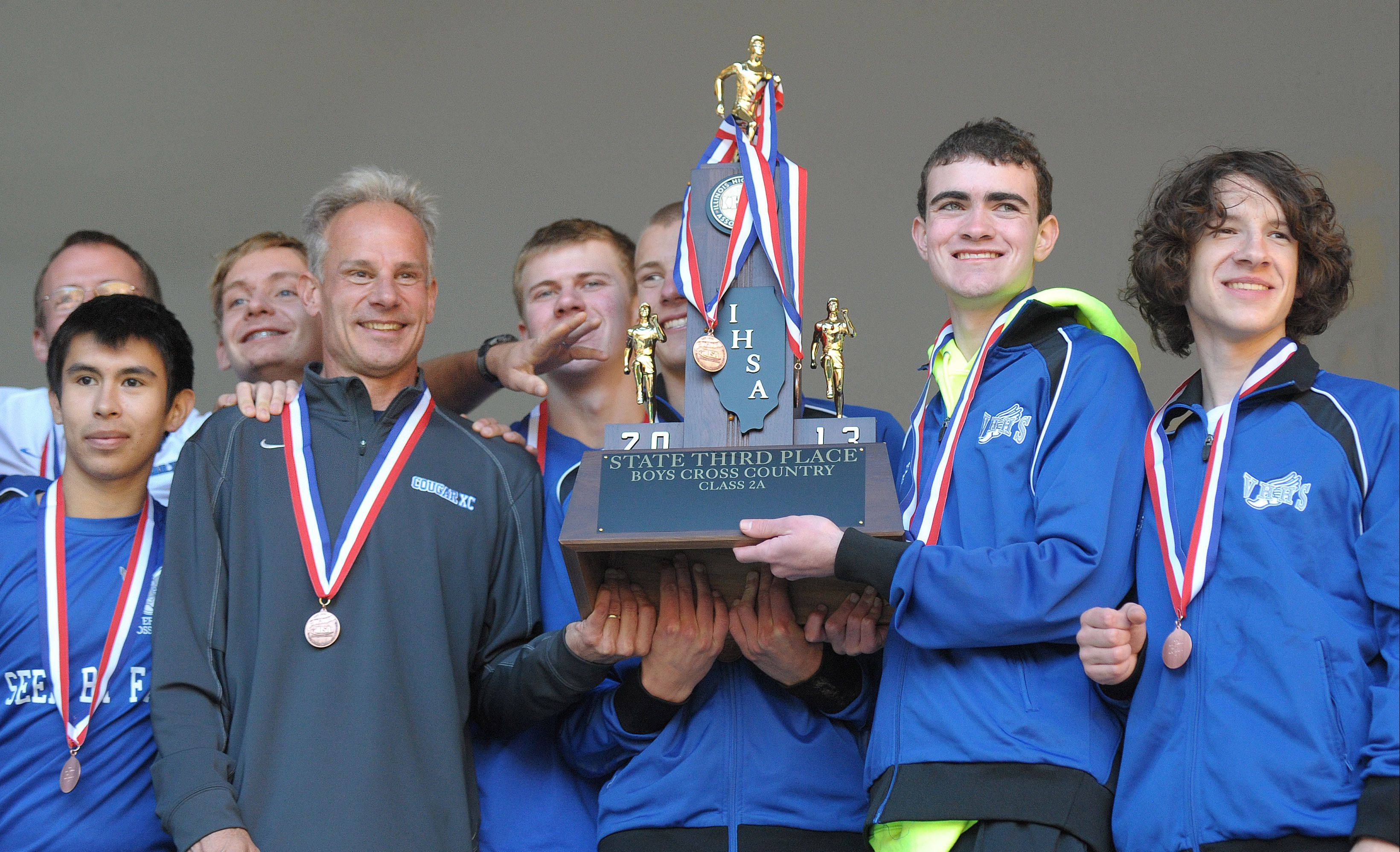 Vernon Hills claims its third-place Class 2A state trophy at Detweiller Park in Peoria on Saturday.