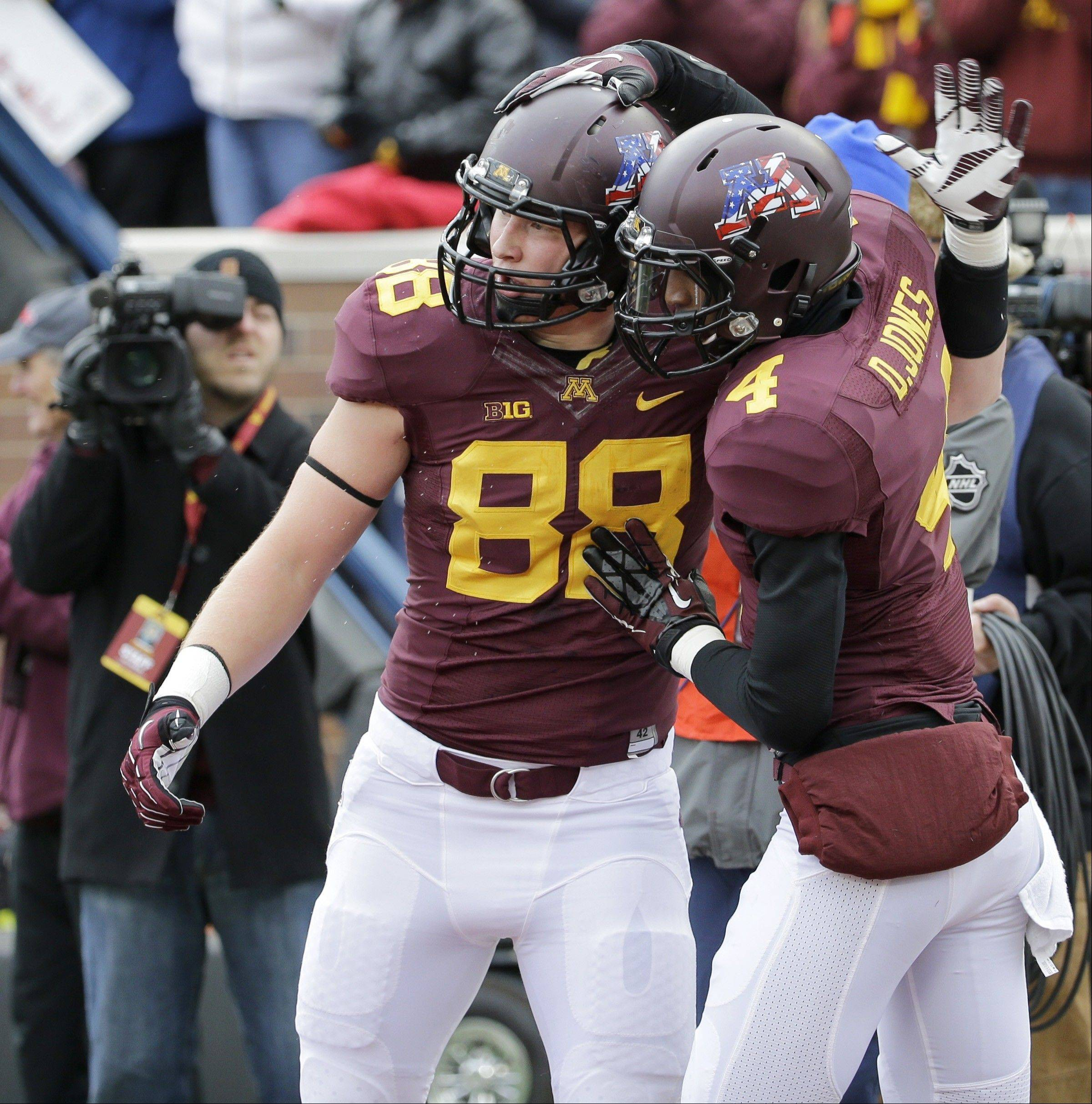Minnesota tight end Maxx Williams (88) and Donovahn Jones (4) celebrate Williams' touchdown during the second quarter of an NCAA college football game against Penn State in Minneapolis, Saturday, Nov. 9, 2013. (AP Photo/Ann Heisenfelt)