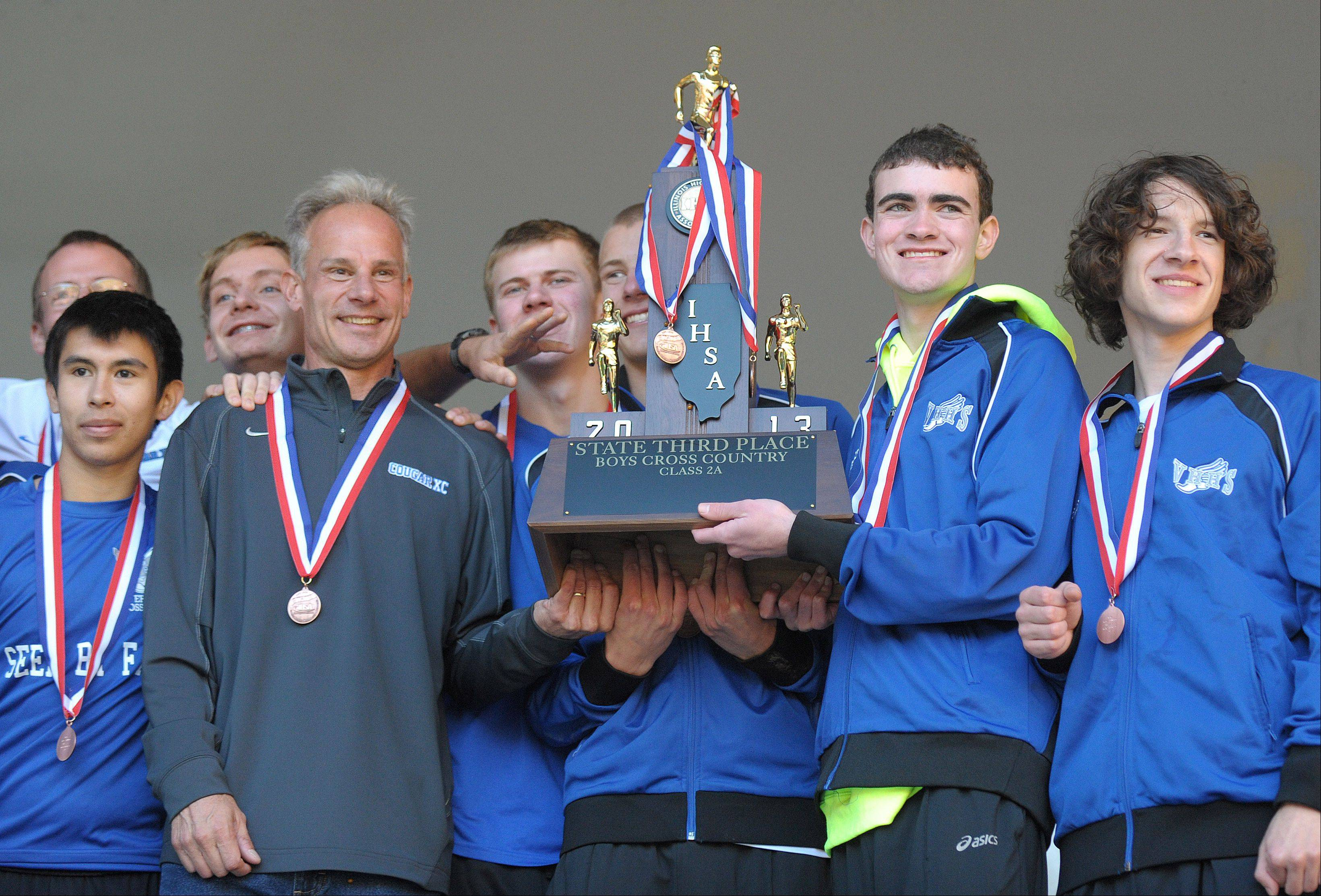 Vernon Hills claims their third place Class 2A IHSA cross country state trophy at Detweiller Park in Peoria on Saturday, November 9.