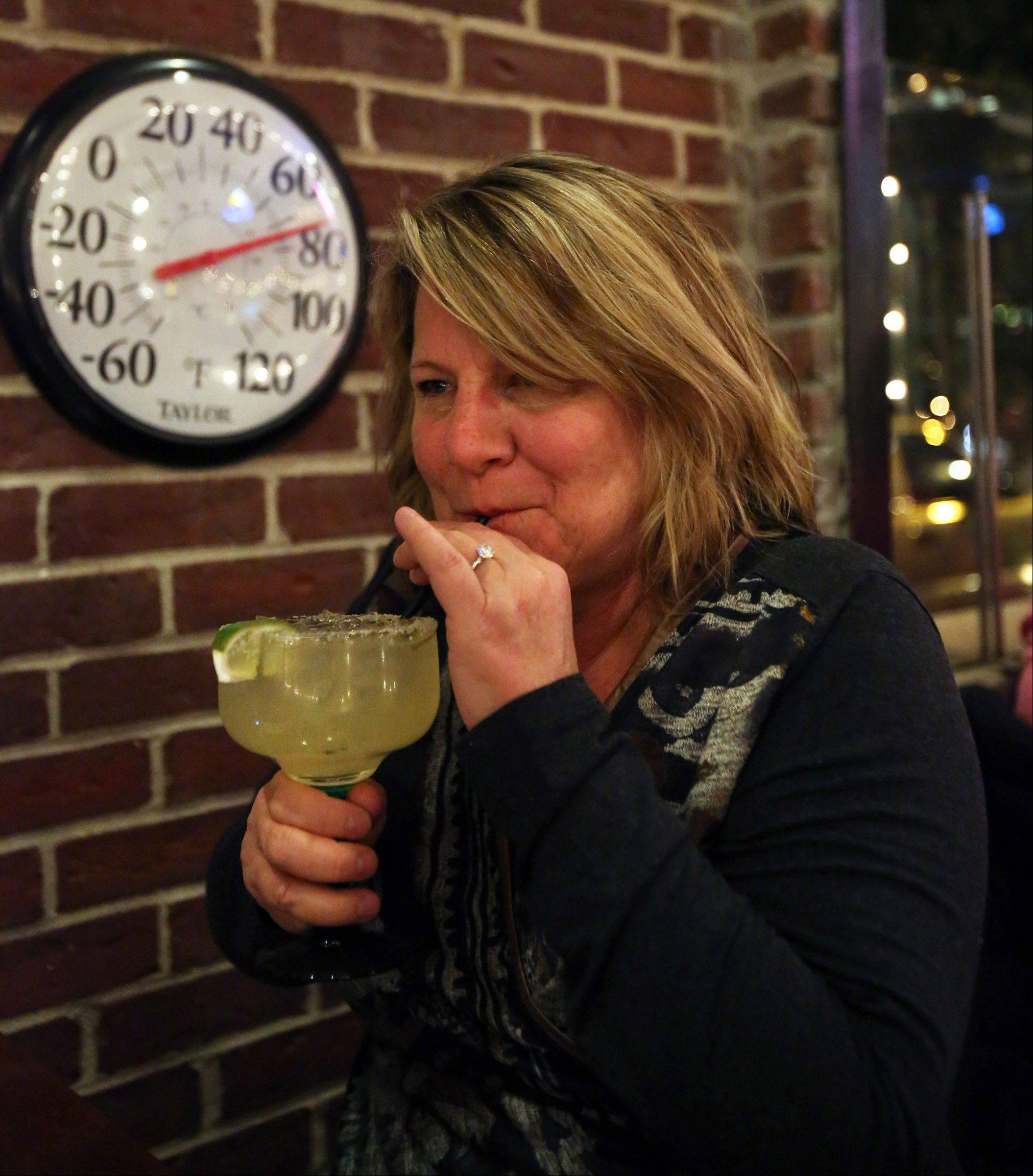 Even on a cool November night, the patio at Casa Bonita Mexican Restaurant and Tequila Bar registers a balmy 78 degrees as Dawn Kunkel of Libertyville enjoys a cold margarita.
