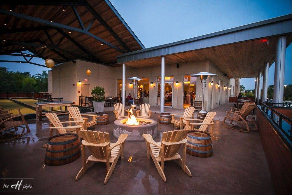 A fire pit on the patio at Pinstripes in South Barrington gives customers a place to stay warm outdoors.