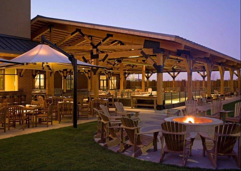A patio fire pit provides a place to stay warm outdoors at Pinstripes in South Barrington.