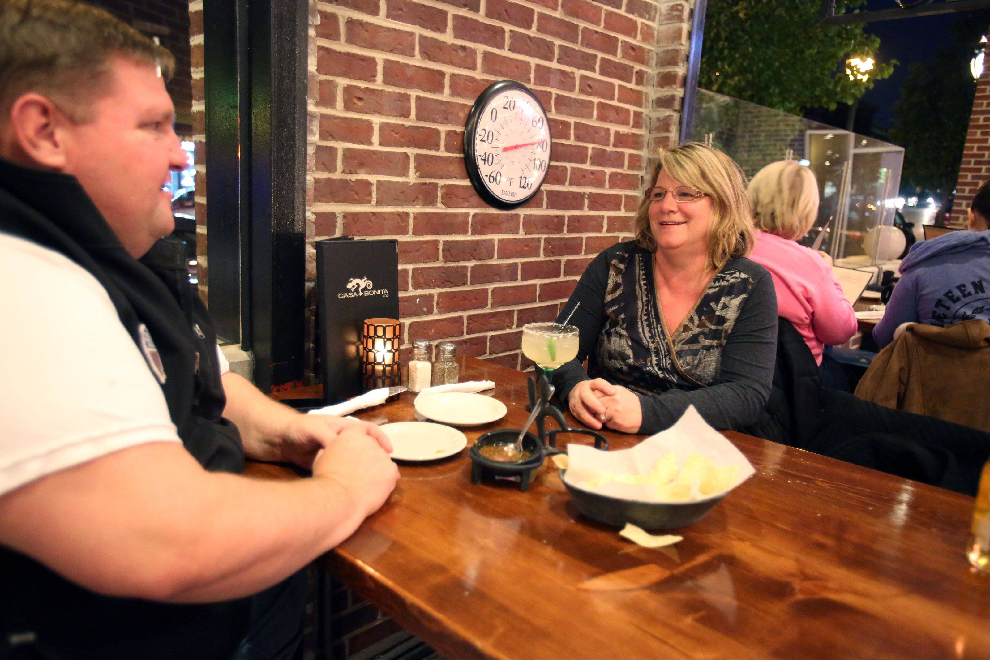 Despite fall temperatures, the patio at Casa Bonita hovers around 80 degrees as Larry and Dawn Kunkel of Libertyville enjoy drinks outdoors.