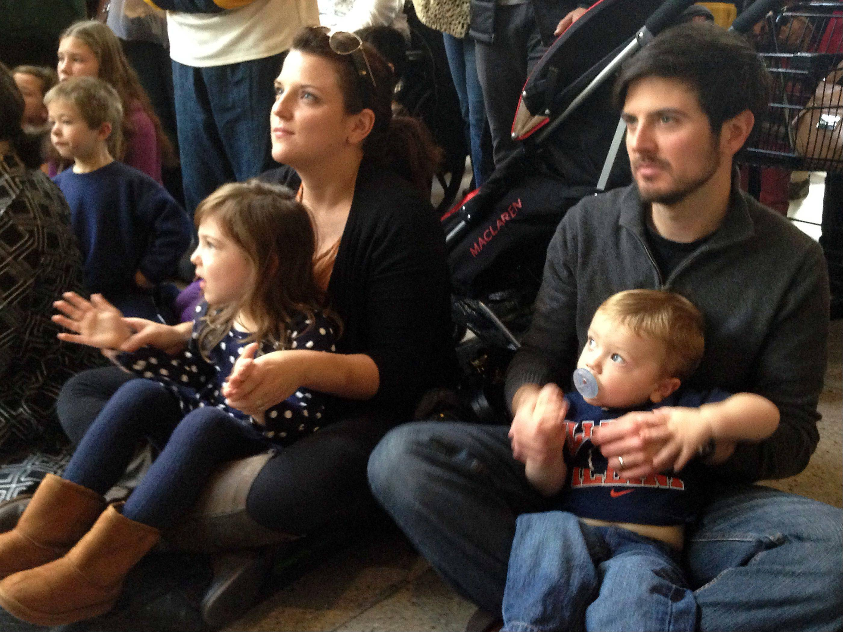 Dave and Carrie Jodelka, with their kids Penny, 4, and Jimmy, 18 months, watched a performance by the cast of the Chicago musical Million Dollar Quartet on Saturday at Yorktown Center in Lombard.
