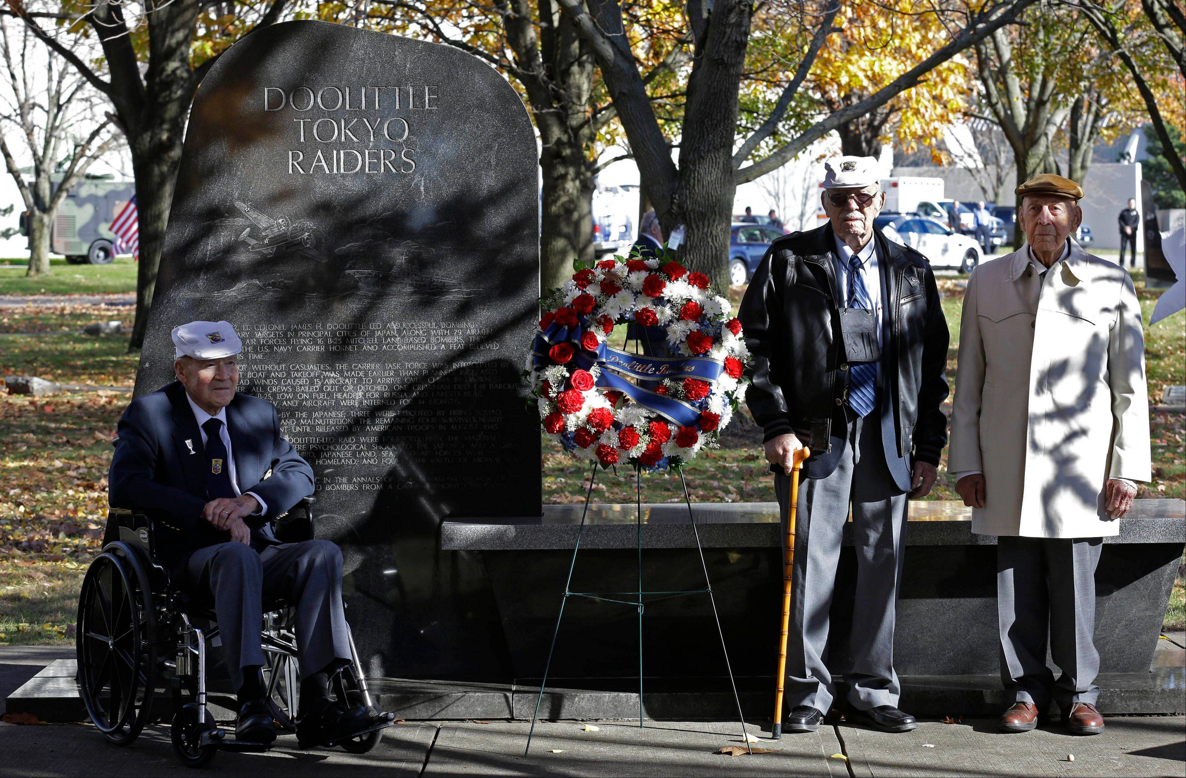 Three of the four surviving members of the 1942 Tokyo raid led by Lt. Col. Jimmy Doolittle, left to right, David Thatcher, Edward Saylor, and Richard Cole, pose Saturday next to a monument marking the raid.