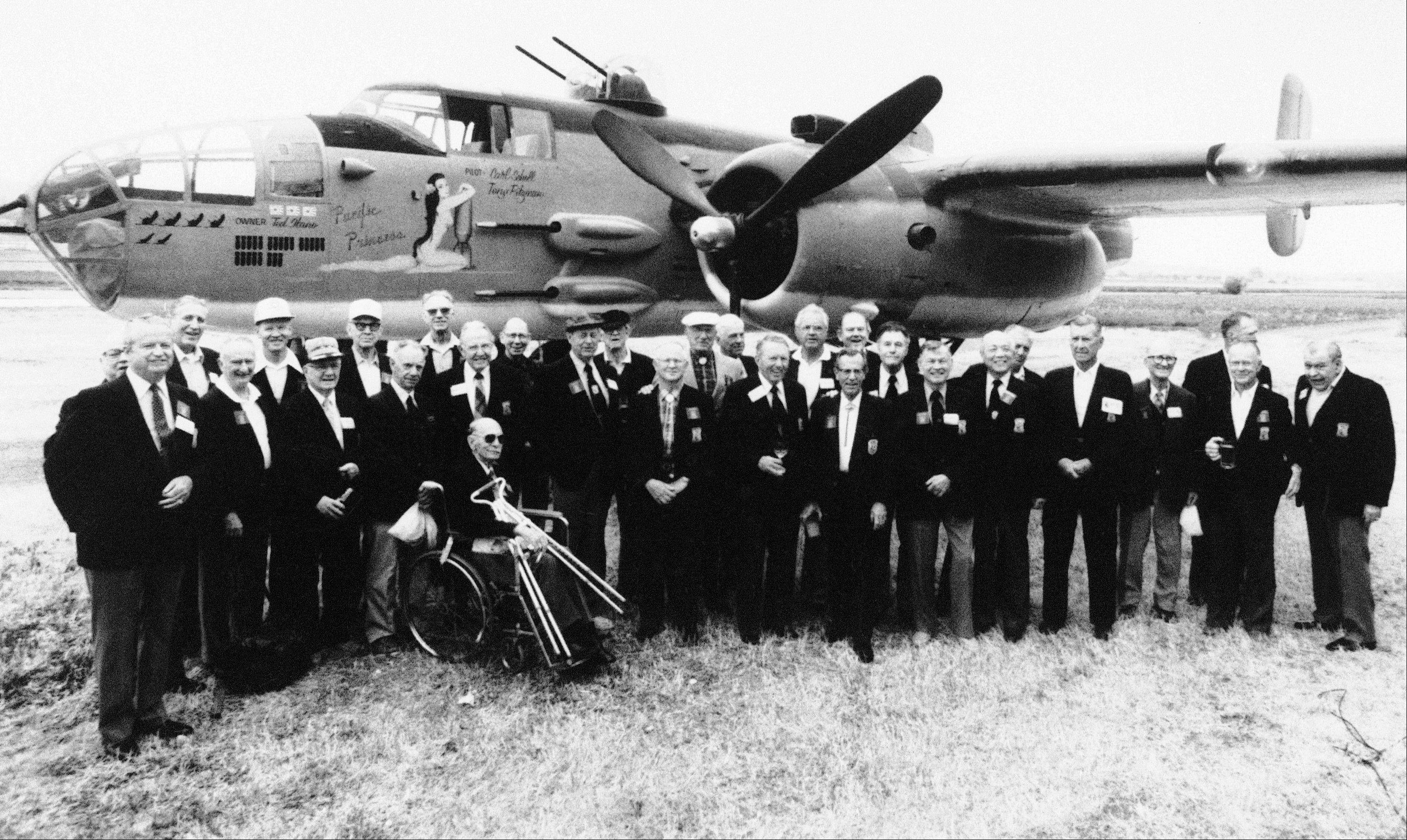 Thirty members of Jimmy Doolittle's Tokyo Raiders pose for a group picture in front of a B-25J bomber in Torrance, Calif., as they gather for a reunion.