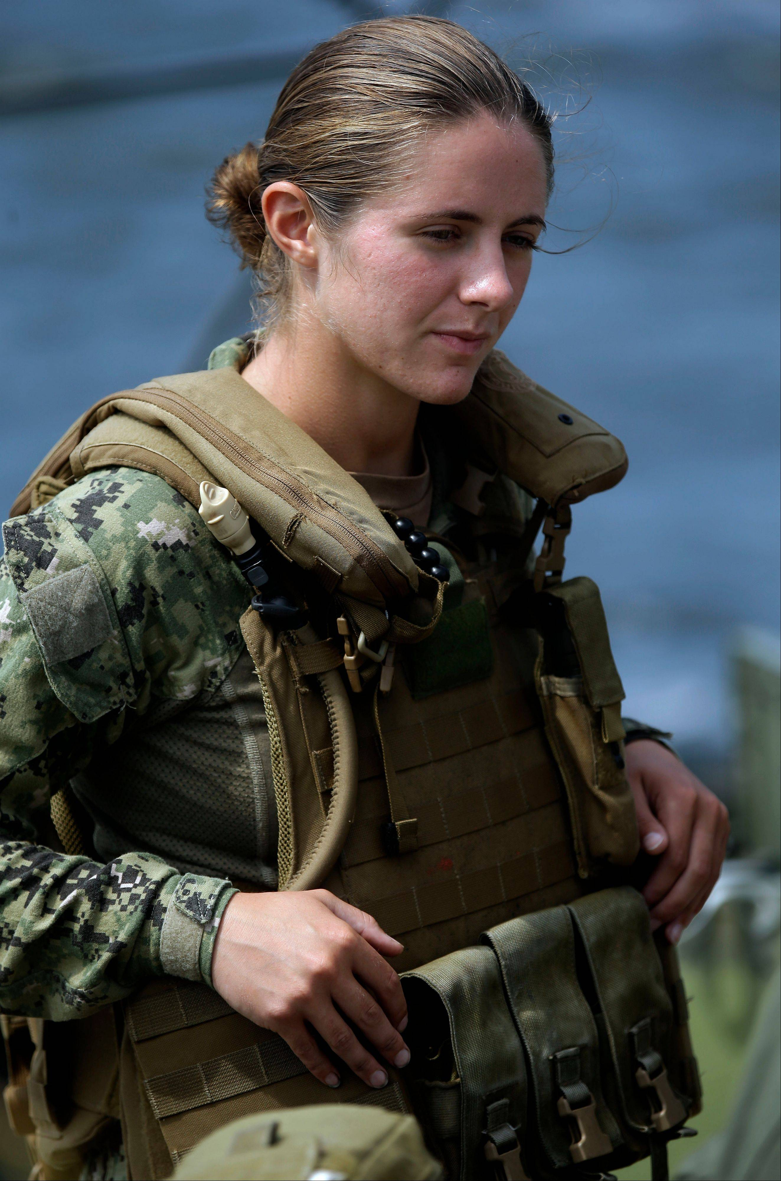 Navy Master-at-Arms Third Class Danielle Hinchliff of Coastal Riverine Squadron 2 listens while training during a U.S. Navy Riverine Crewman Course at the Center for Security Forces Learning Site at Camp Lejeune, N.C. This is the first time female participants have received this training as they begin to assume roles in combat.
