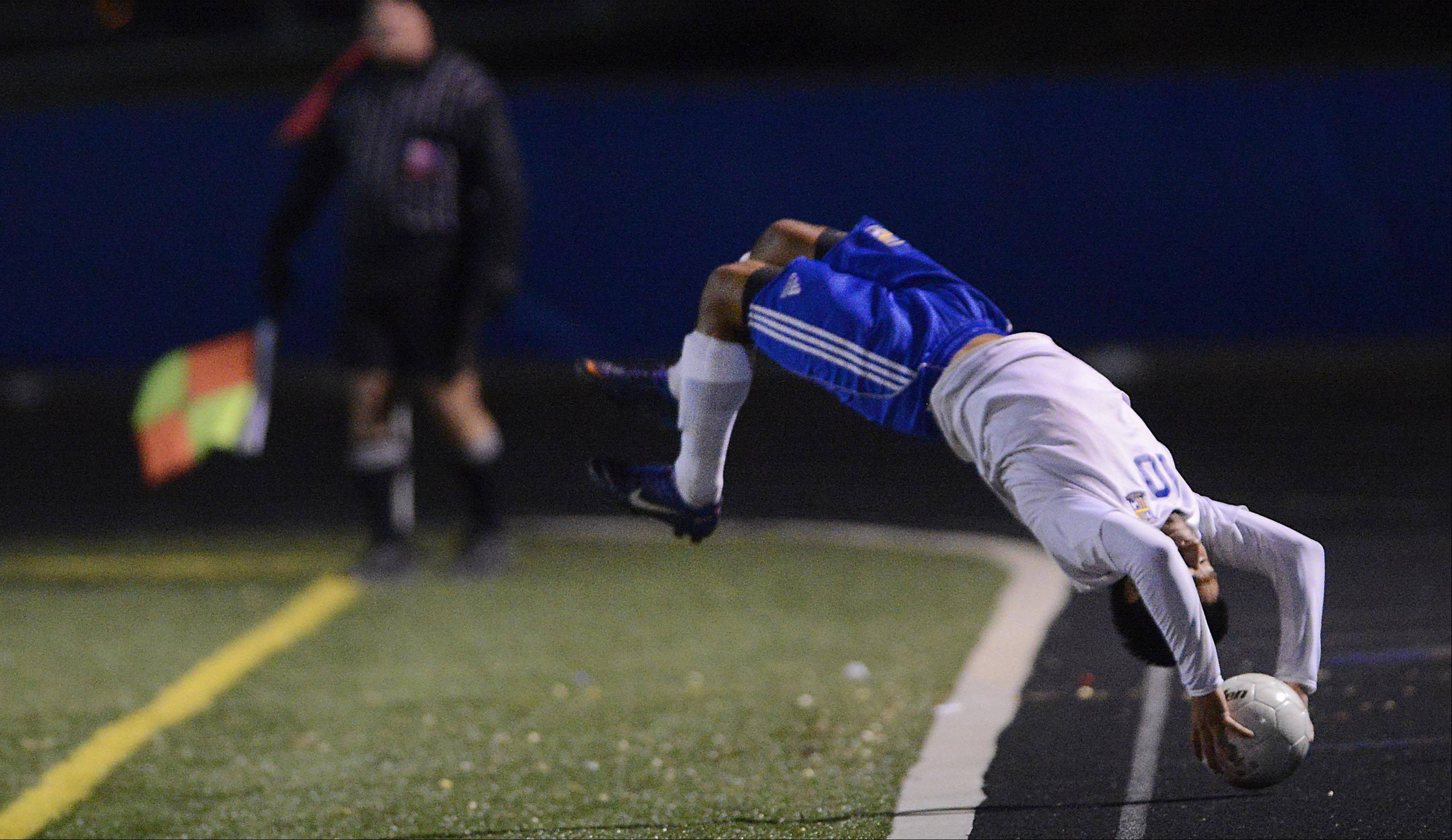 Wheeling's Ivan Mancilla delivers a flip throw-in from the sidelines in the Class 3A boys soccer state championship game Saturday night in Hoffman Estates.