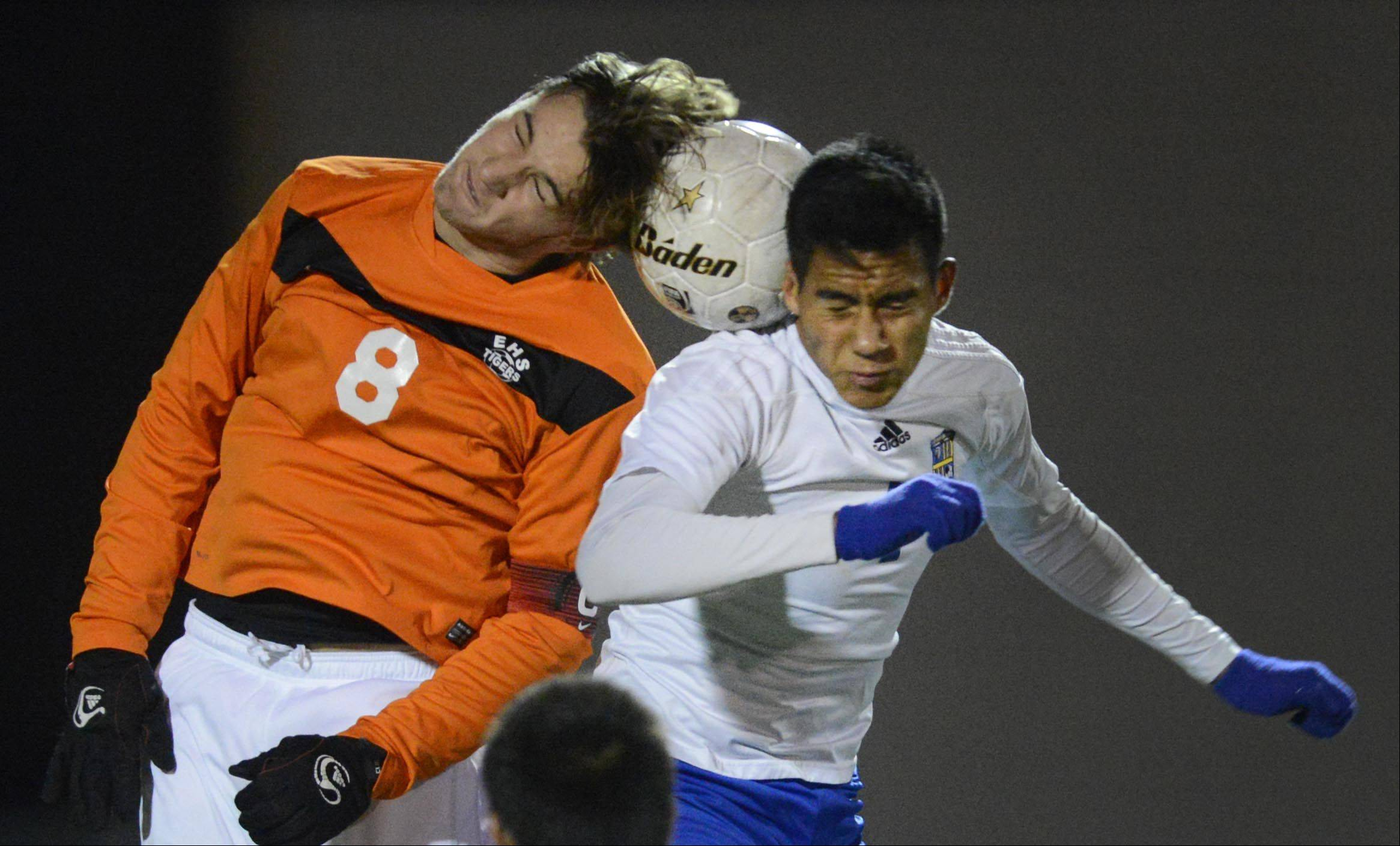 Wheeling's Francisco Arellano and Edwardsville's Josh Kowalis compete for a header in the Class 3A boys soccer state championship game Saturday night in Hoffman Estates.