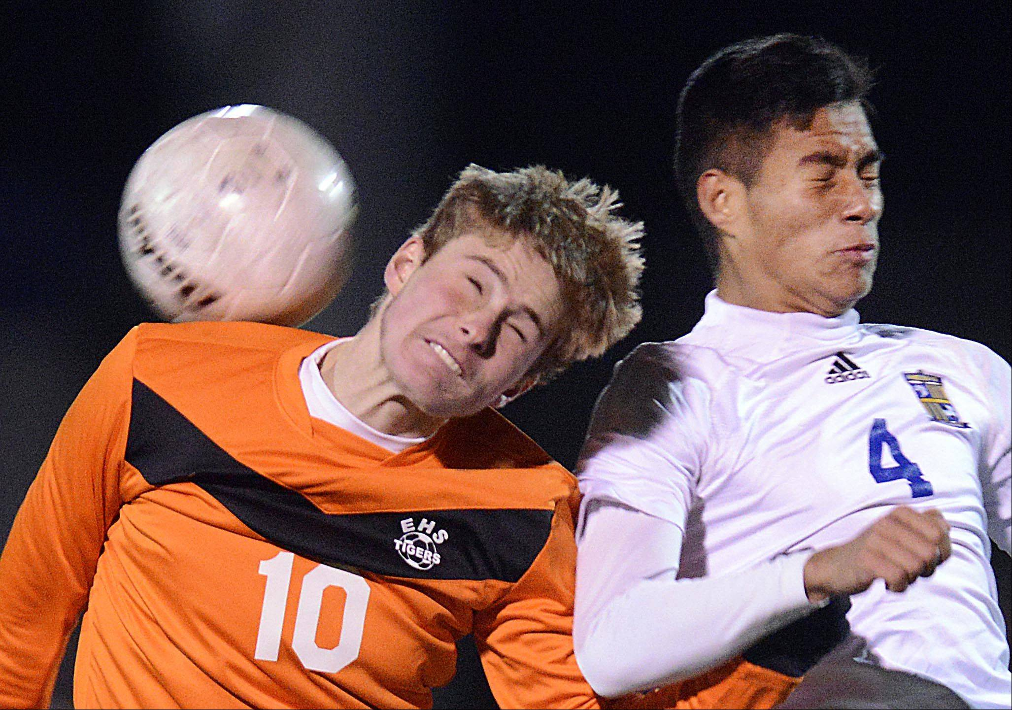 Wheeling's Francisco Arellano and Edwardsville's Lando Paul compete for a header in the Class 3A boys soccer state championship game Saturday night in Hoffman Estates.