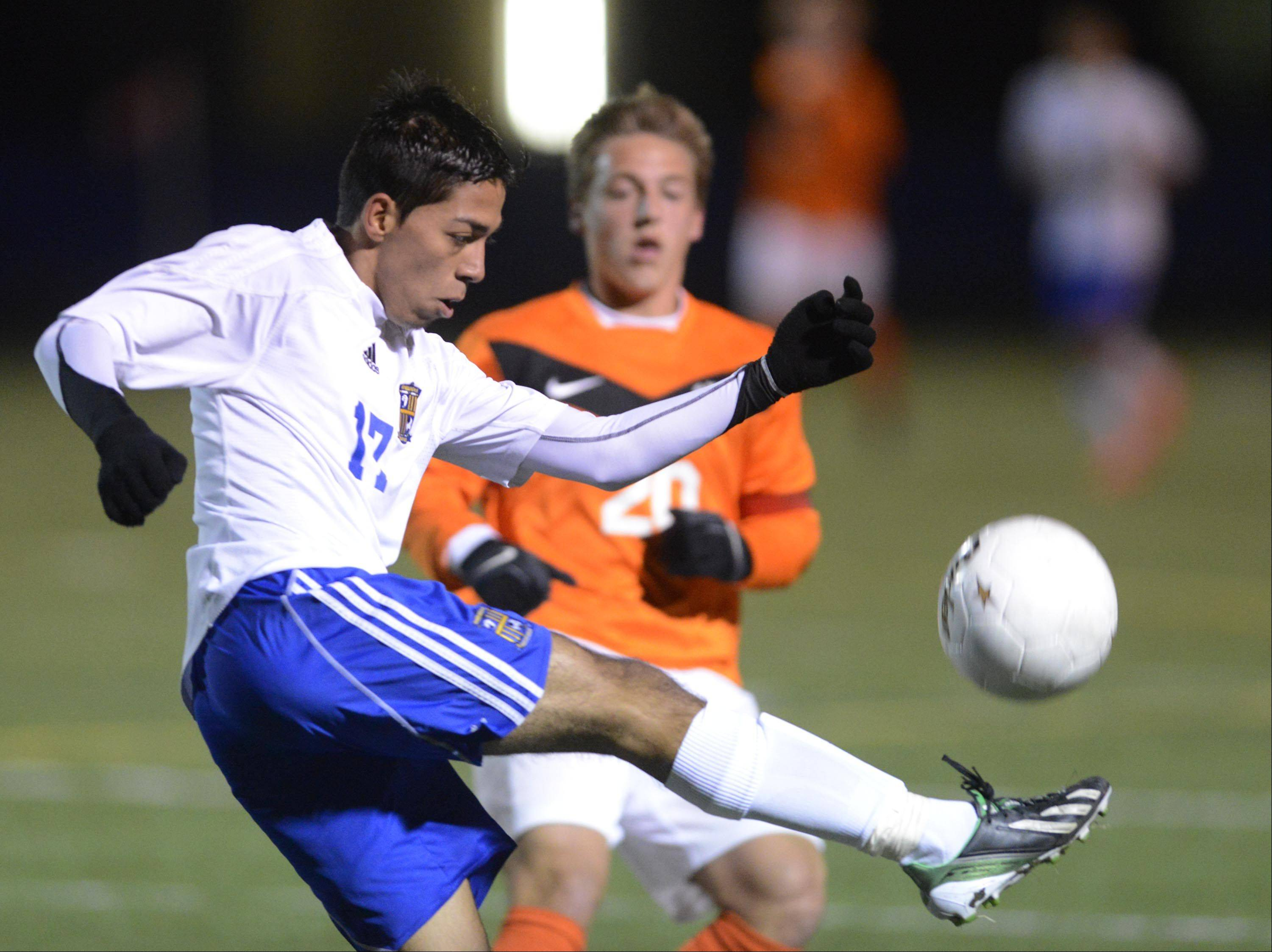 Wheeling's Fabian Acosta advances the ball upfield against Edwardsville in the Class 3A boys soccer state championship game Saturday night in Hoffman Estates.