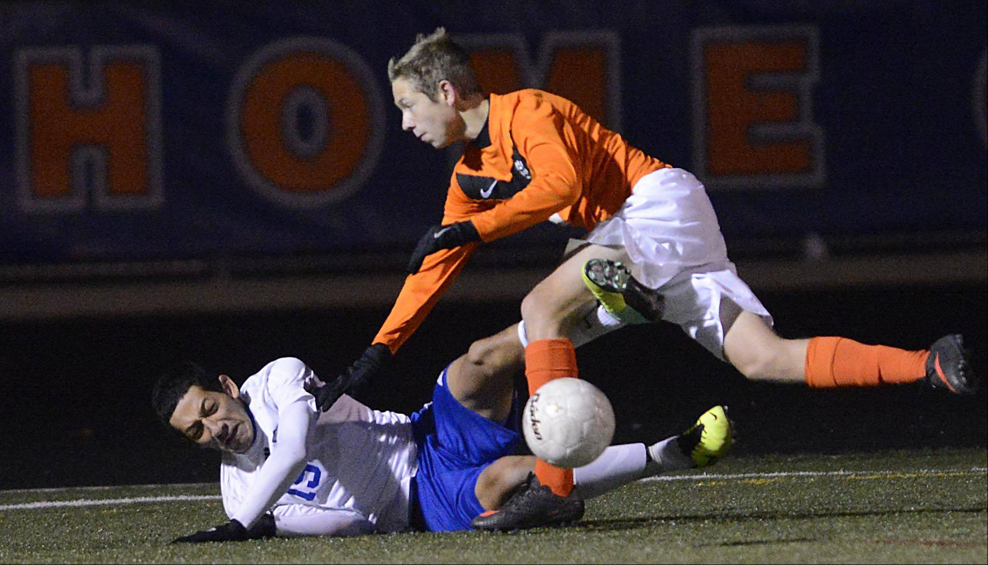 Wheeling's Michael Hernandez falls as he tangles with Edwardsville's Tommy Giacobbe in the Class 3A boys soccer state championship game Saturday night in Hoffman Estates.
