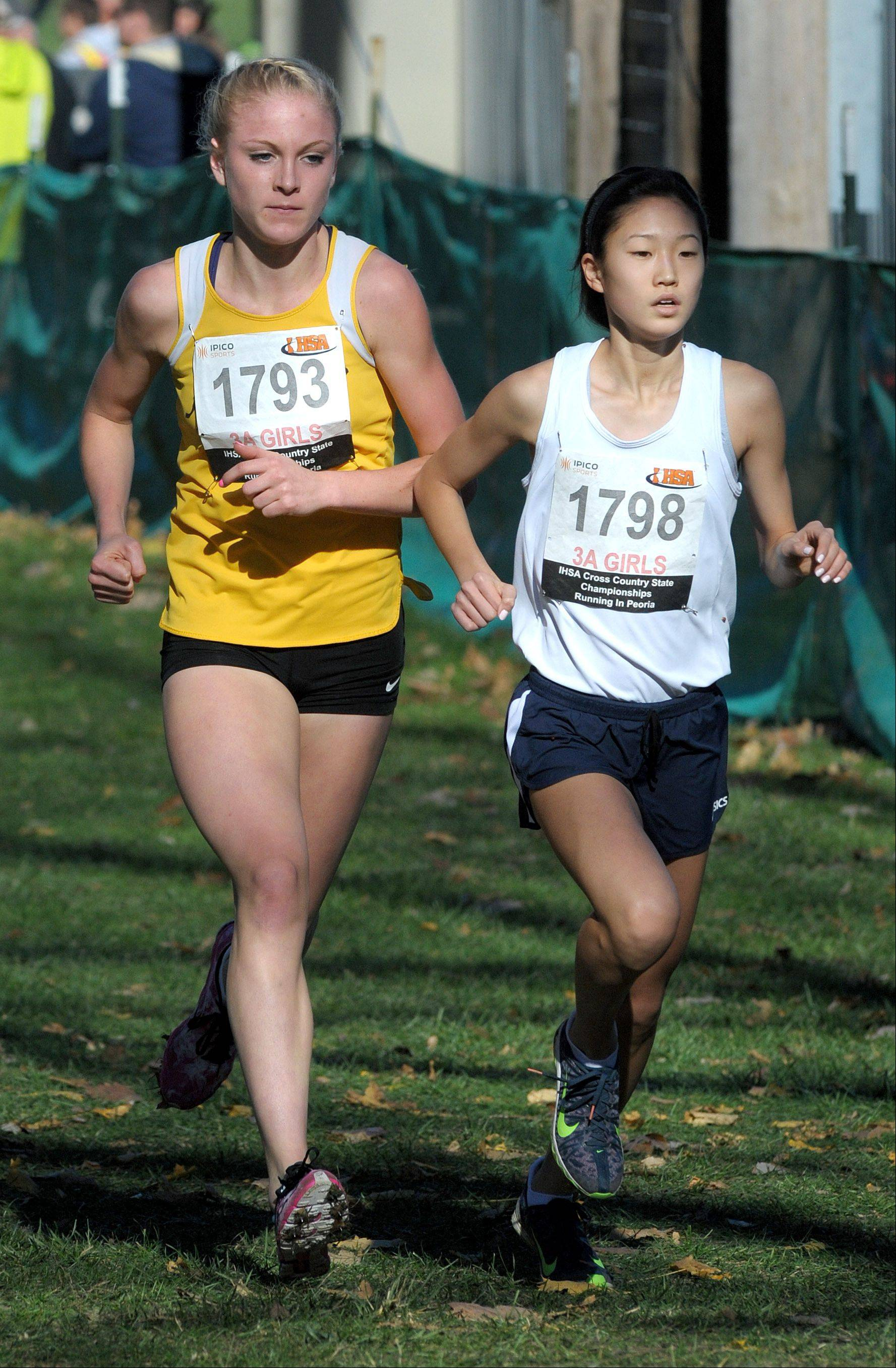 Jacob's Lauren Van Vlierbergen (1793) and Buffalo Grove's Kaitlyn Ko compete in the Class 3A IHSA cross country state finals at Detweiller Park in Peoria on Saturday, November 9.