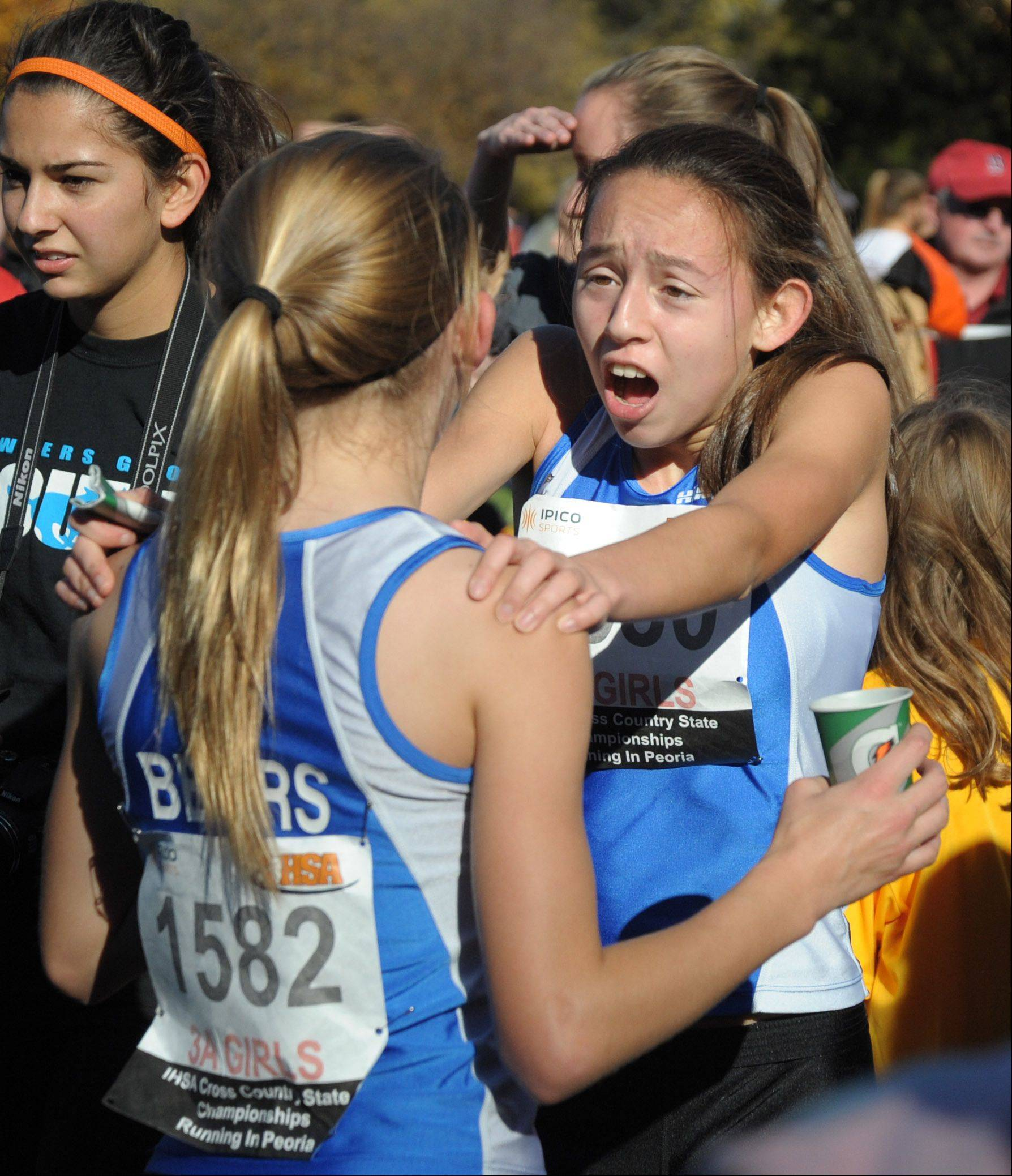 Lake Zurich's Kristie Houghton (facing) and Maryjane Koza celebrate after competing in the Class 3A IHSA cross country state finals at Detweiller Park in Peoria on Saturday, November 9.