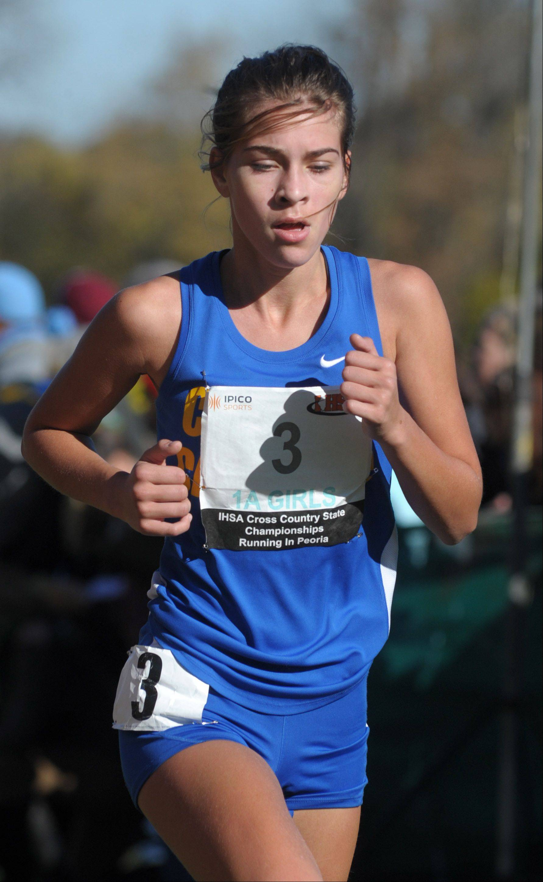 Aurora Central Catholic's Irene Crown nears the finish line to take 68th place in the Class 1A IHSA cross country state final at Detweiller Park in Peoria on Saturday, November 9.