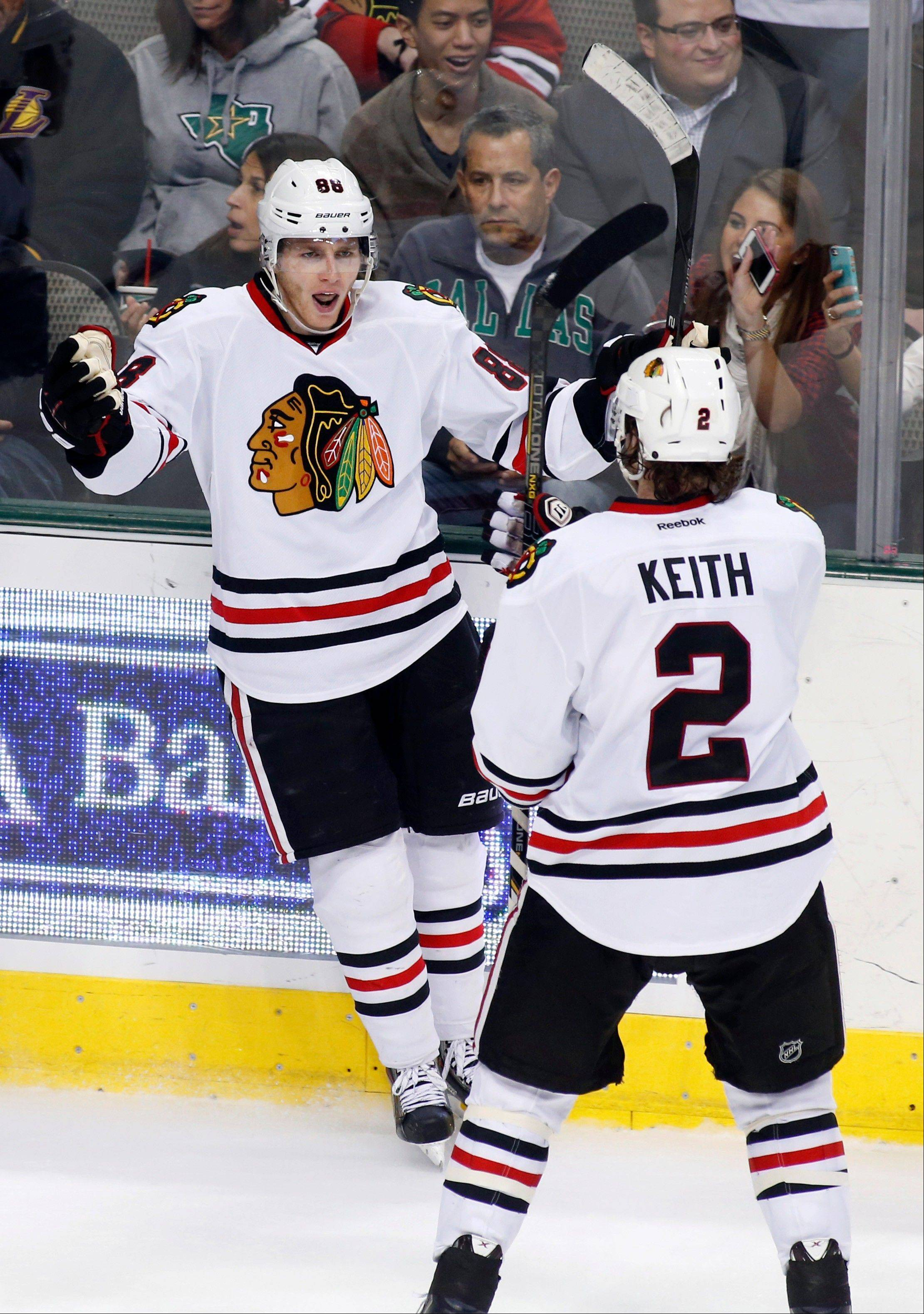 Blackhawks right wing Patrick Kane, left, celebrates his goal with defenseman Duncan Keith (2) during Saturday's game against the Dallas Stars. The Hawks won 5-2.