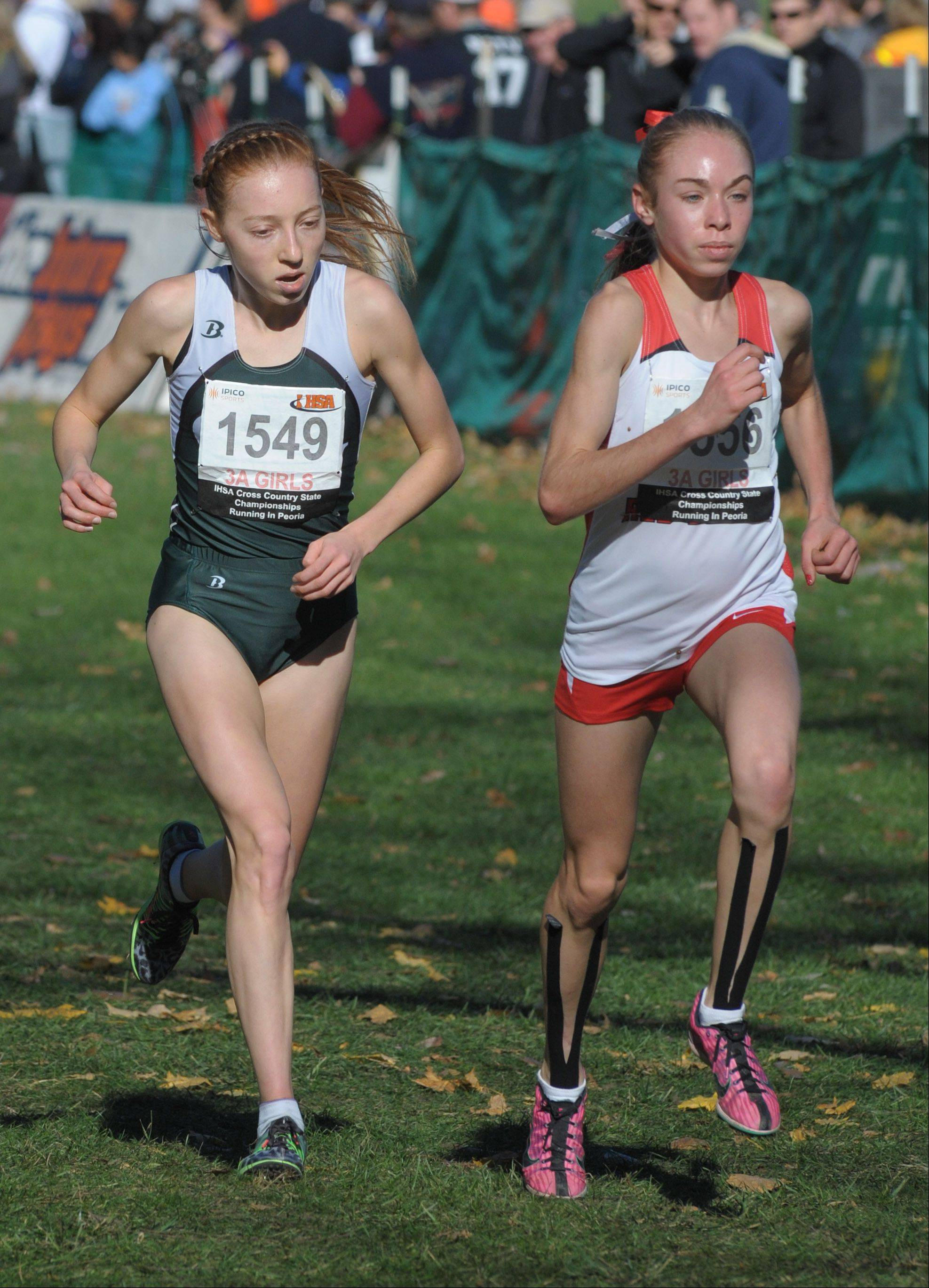 Glenbard West's Madeline Perez (1549) and Hinsdale Central's Alexa battle to the finish line of the Class 3A IHSA cross country state finals at Detweiller Park in Peoria on Saturday, November 9.