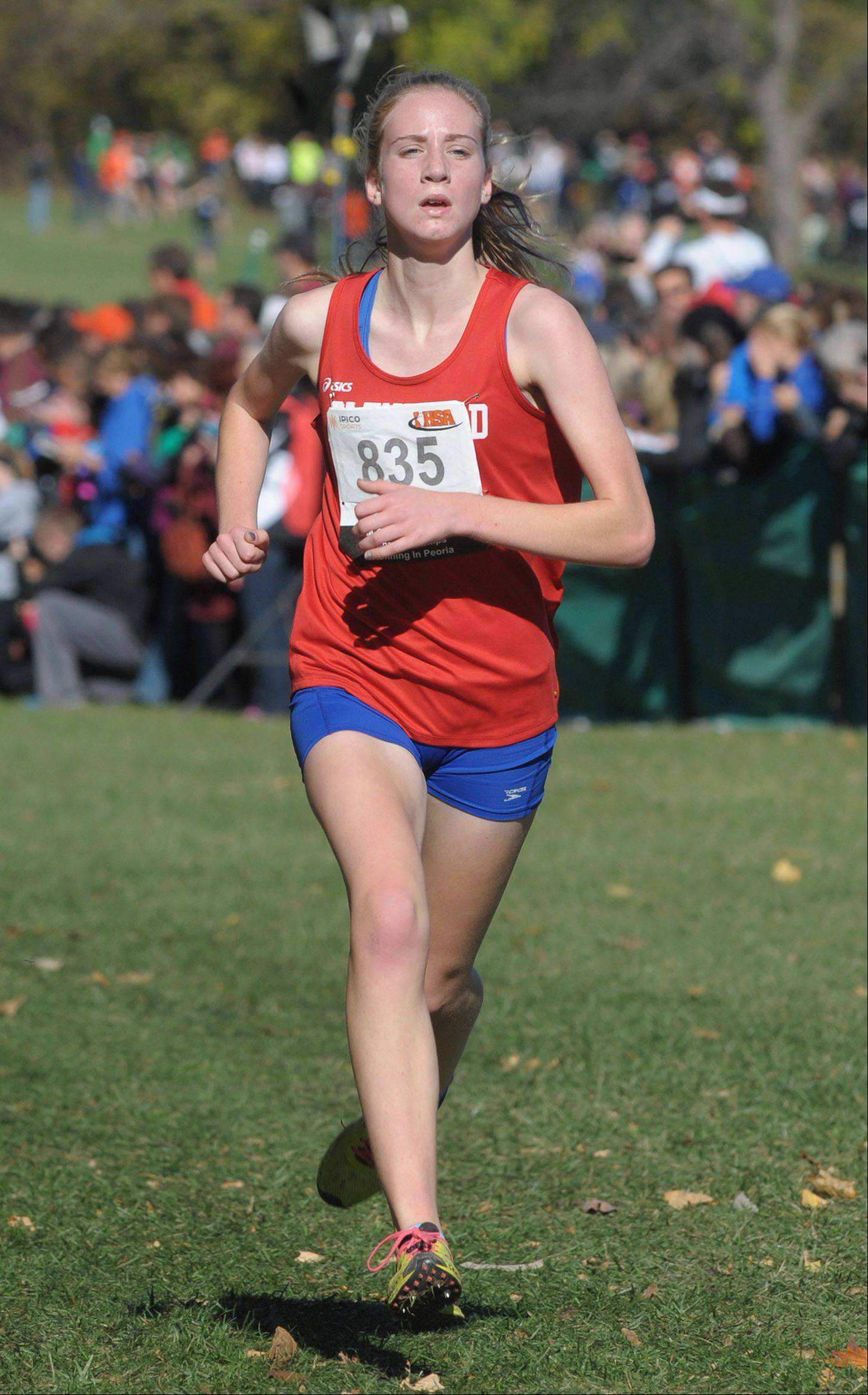 Glenbard South's Diane Lipa approaches the finish line to take third place in the Class 2A IHSA cross country state final at Detweiller Park in Peoria on Saturday, November 9.