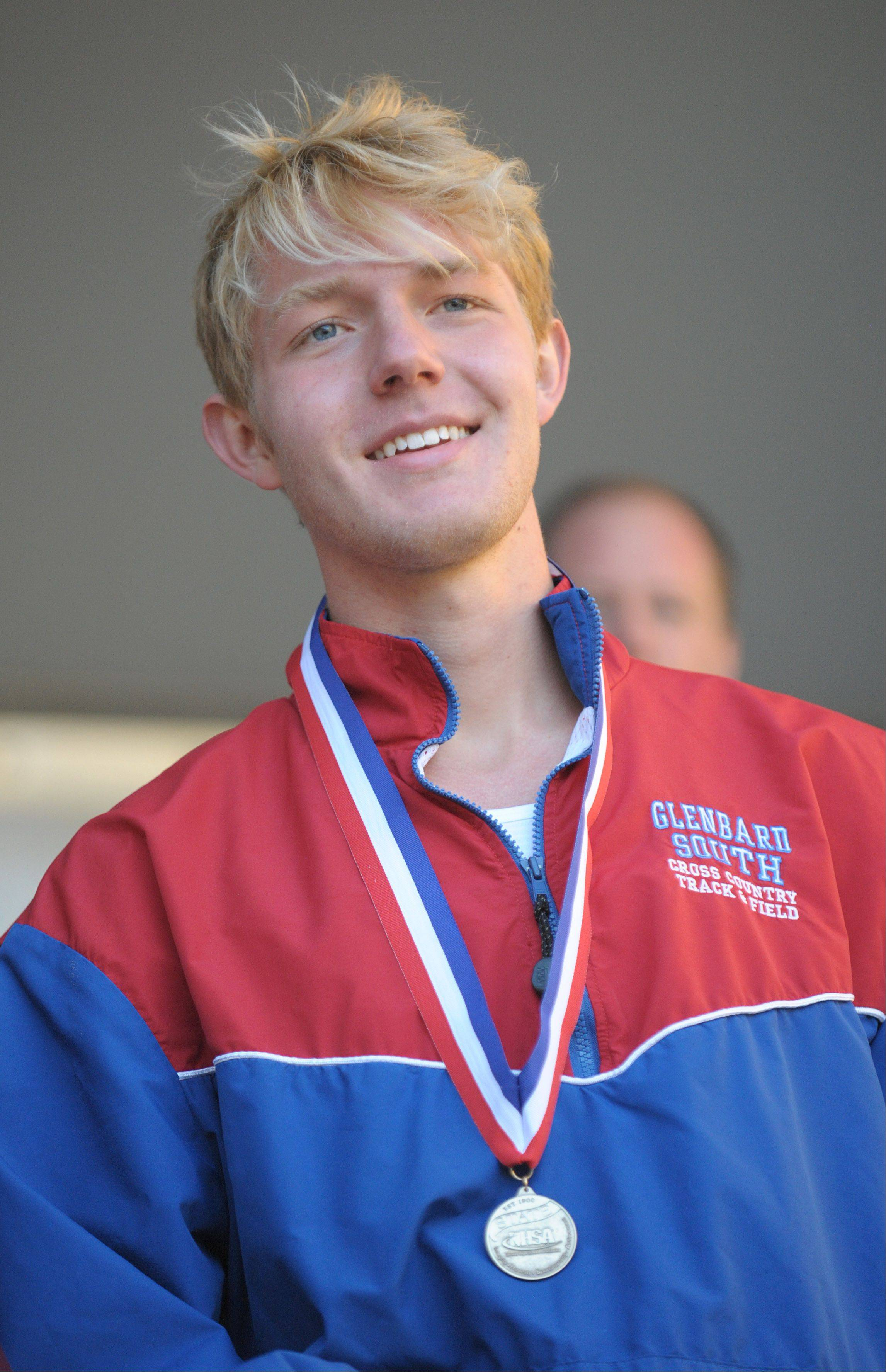 Glenbard South's John Wold accepts his medal for taking first place in the Class 2A IHSA cross country state final at Detweiller Park in Peoria on Saturday, November 9.