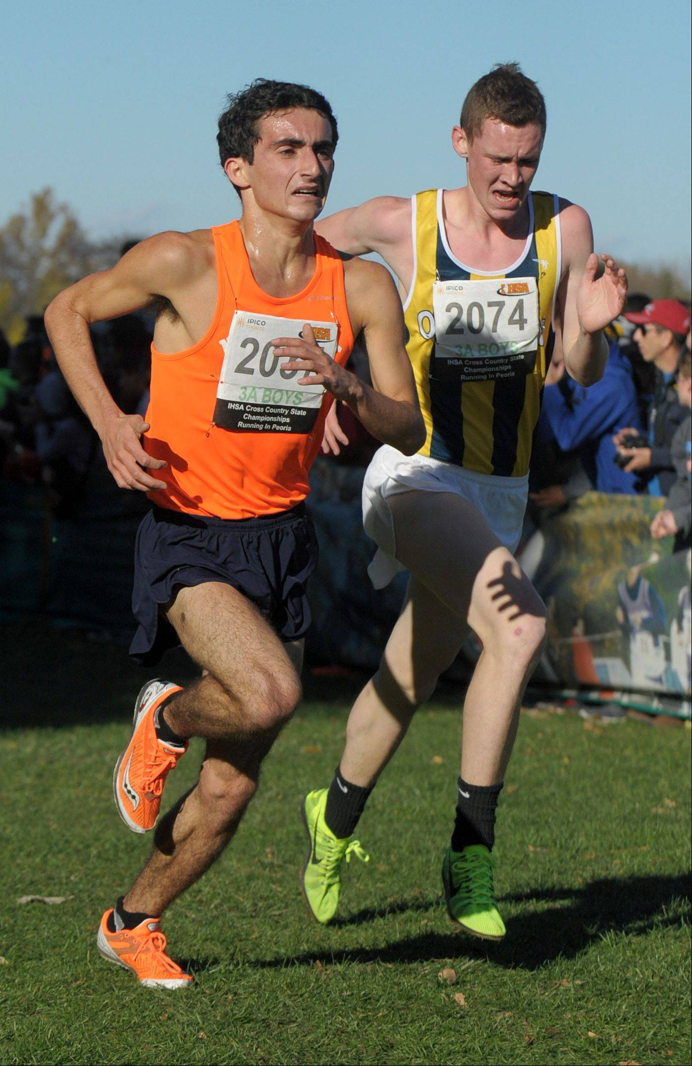 Naperville North's Jake Pecorin (left) takes 54th place beating O'Fallon's Evan Wesslund in the Class 3A IHSA cross country state final at Detweiller Park in Peoria on Saturday, November 9.