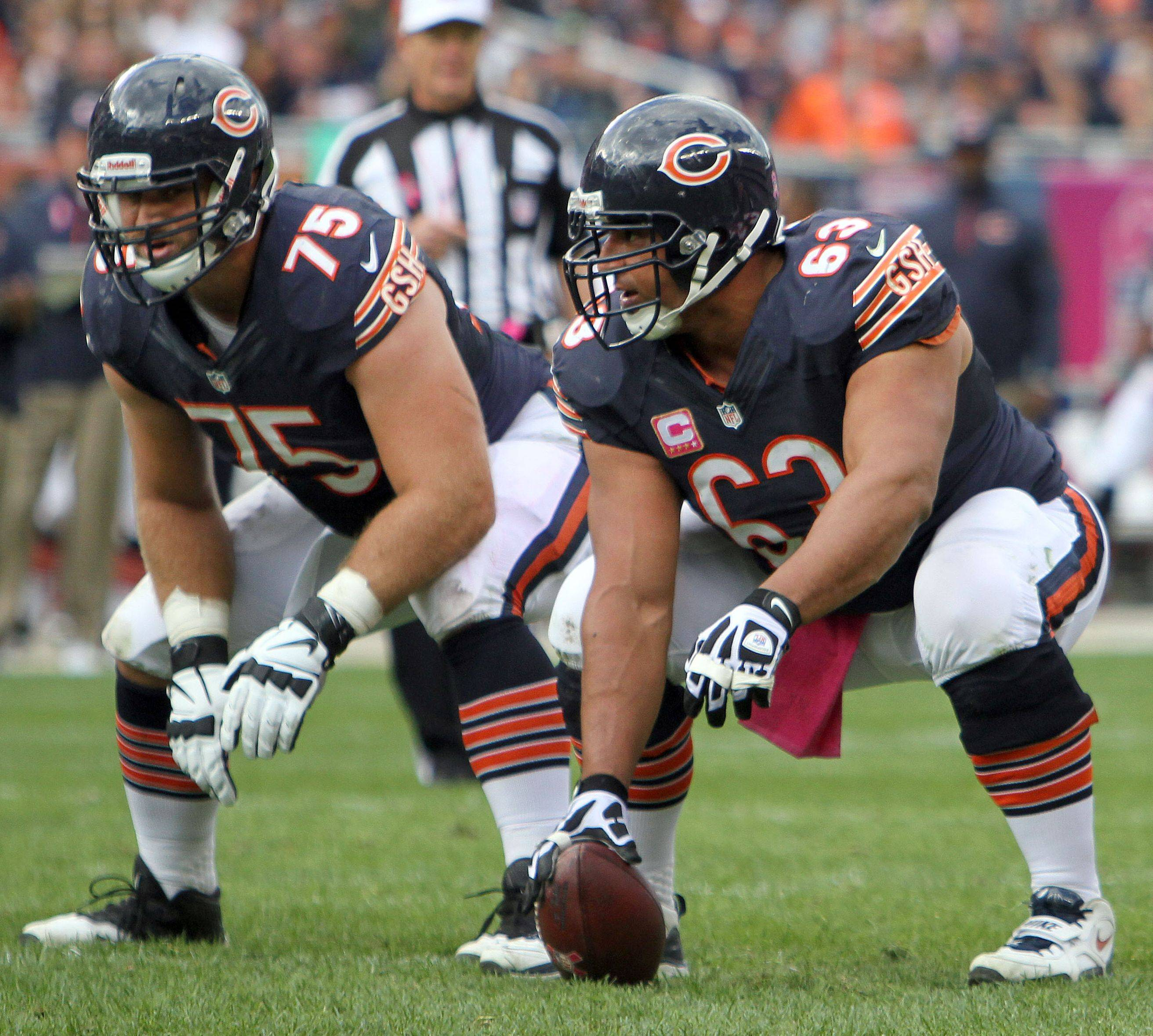 Bears center Roberto Garza (63) is the only remaining starter from last year's offensive line. Rookie guard Kyle Long (75), rookie tackle Jordan Mills and free agents Jermon Bushrod and Matt Slausen have teamed with Garza to turn around a unit that struggled to keep pass rushers away from Jay Cutler in past years.