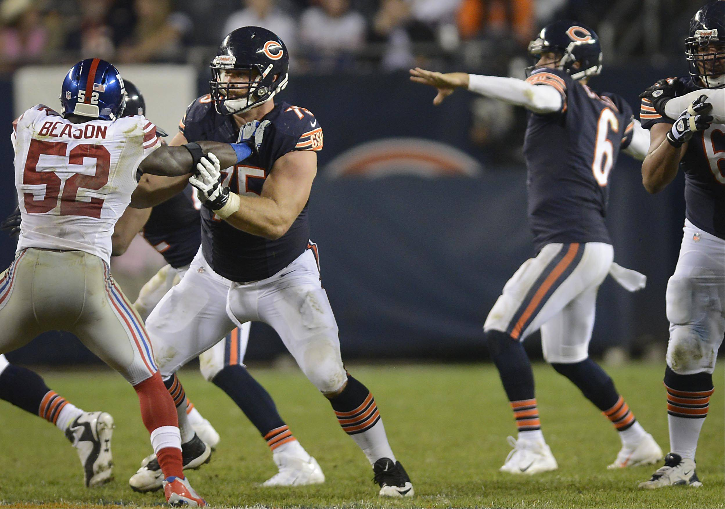 Chicago Bears offensive guard Kyle Long works against New York Giants outside linebacker Jon Beason Thursday night at Soldier Field in Chicago.